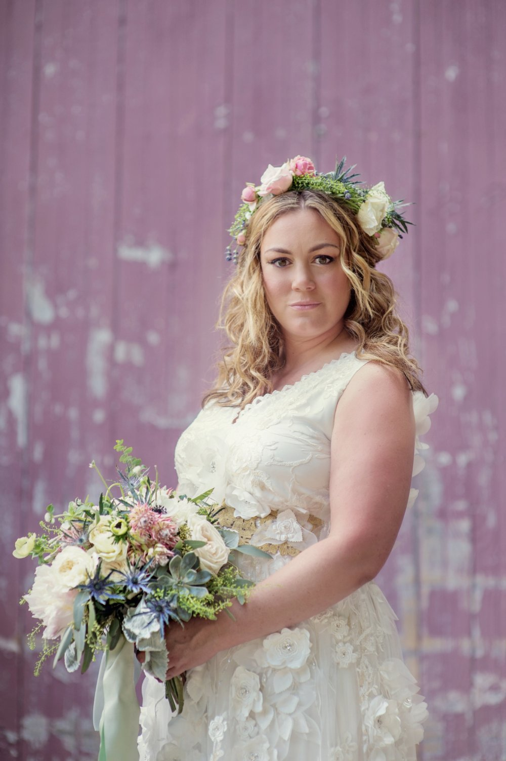 Gorgeous bride with floral crown in a Claire Pettibone gown with rustic bouquet