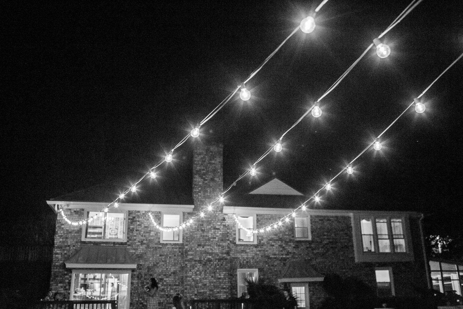 Lights shine over the reception, The Island House, Charleston, South Carolina