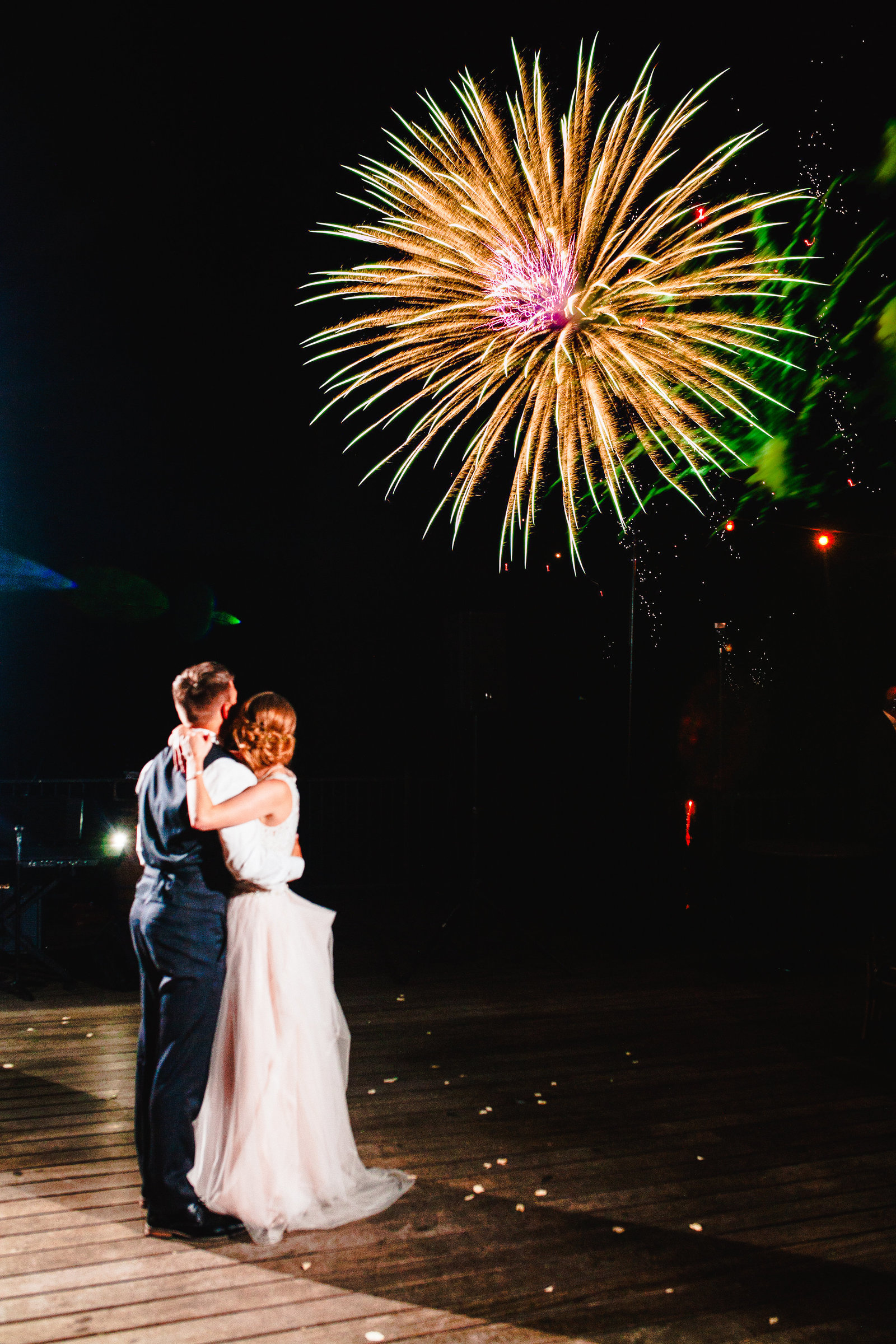 wedding couple on dance floor looking at fireworks in sky St Louis Pinxit Photo