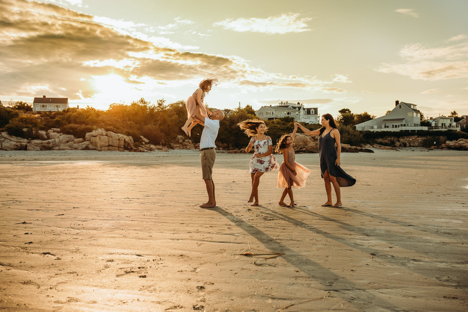 family of five dance on sunset beach in boston family session