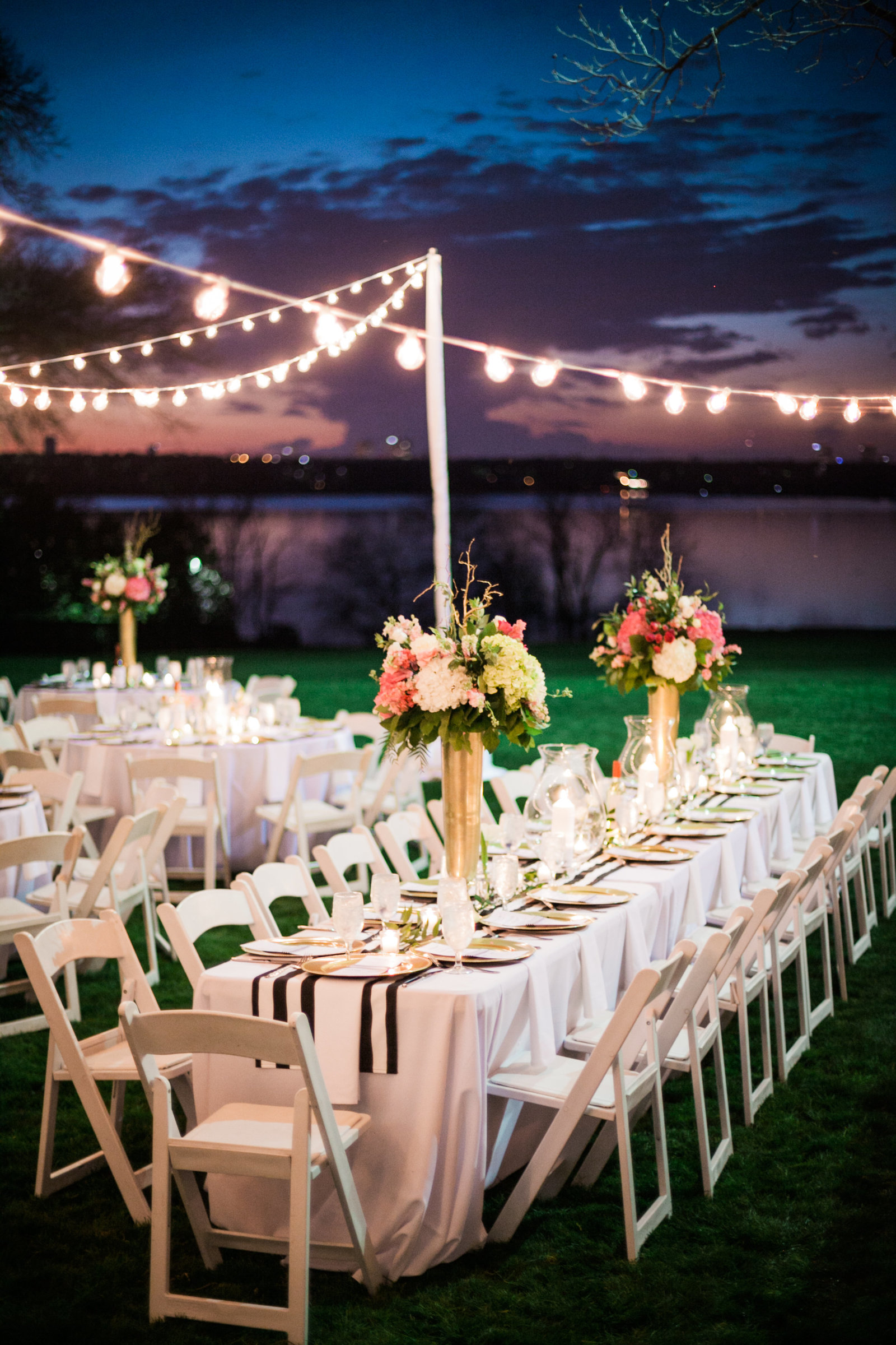 string lights from leforce with tall centerpieces from r love floral at the dallas arboretum at sunset