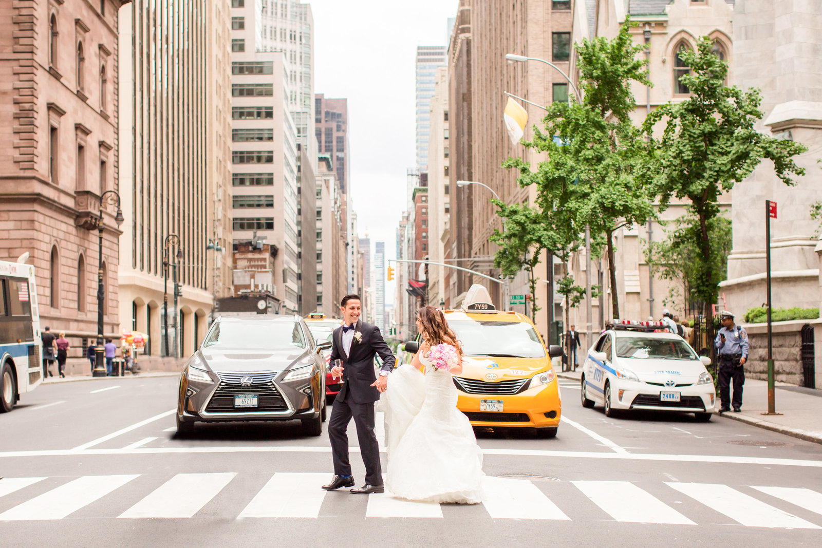 NYC wedding photo of bride and groom crossing the street
