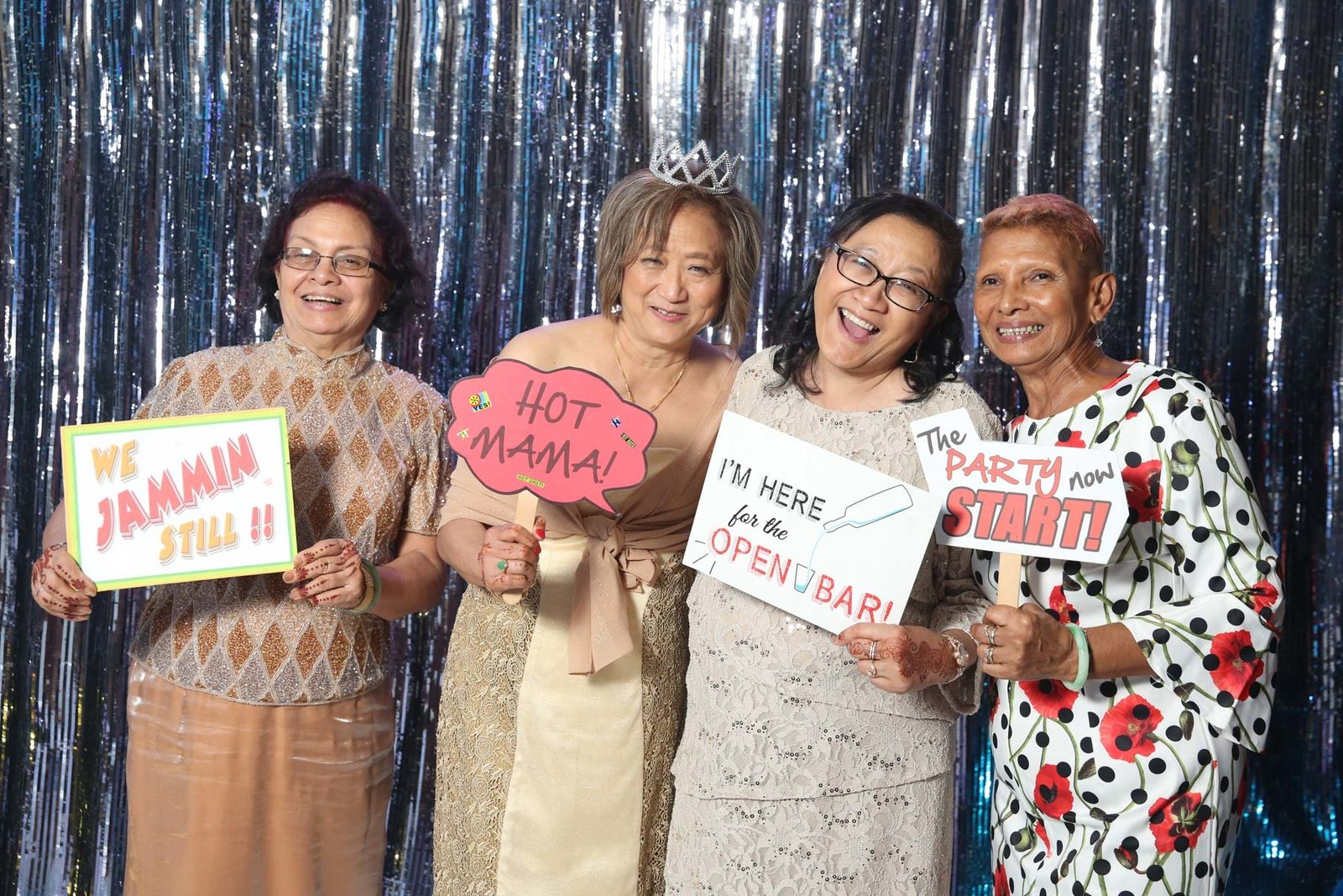 Older ladies holding up funny signs at photobooth. Photo by Ross Photography, Trinidad, W.I..