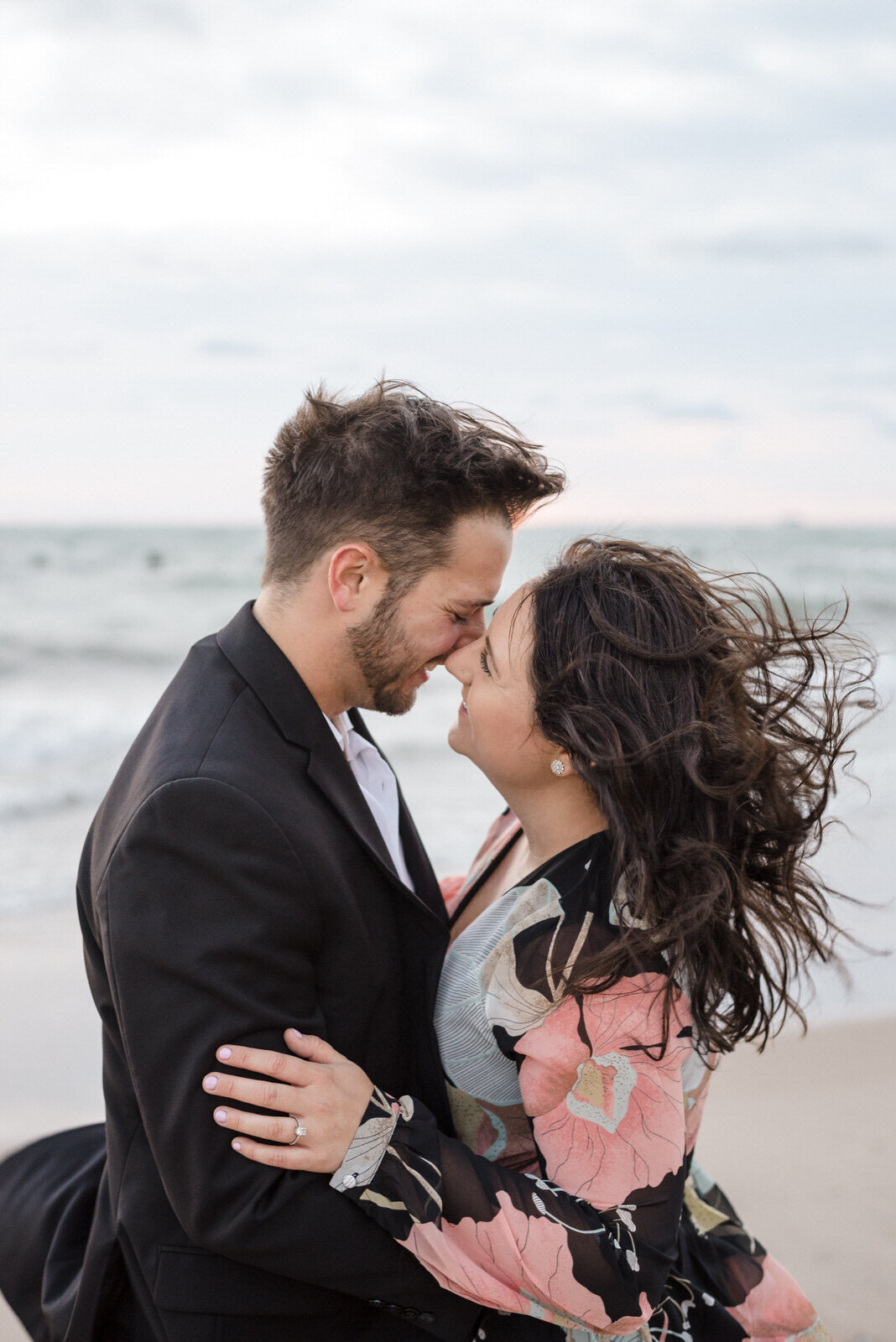 windy-romantic-sunrise-lakefront-engagement-session-white-quill-creative