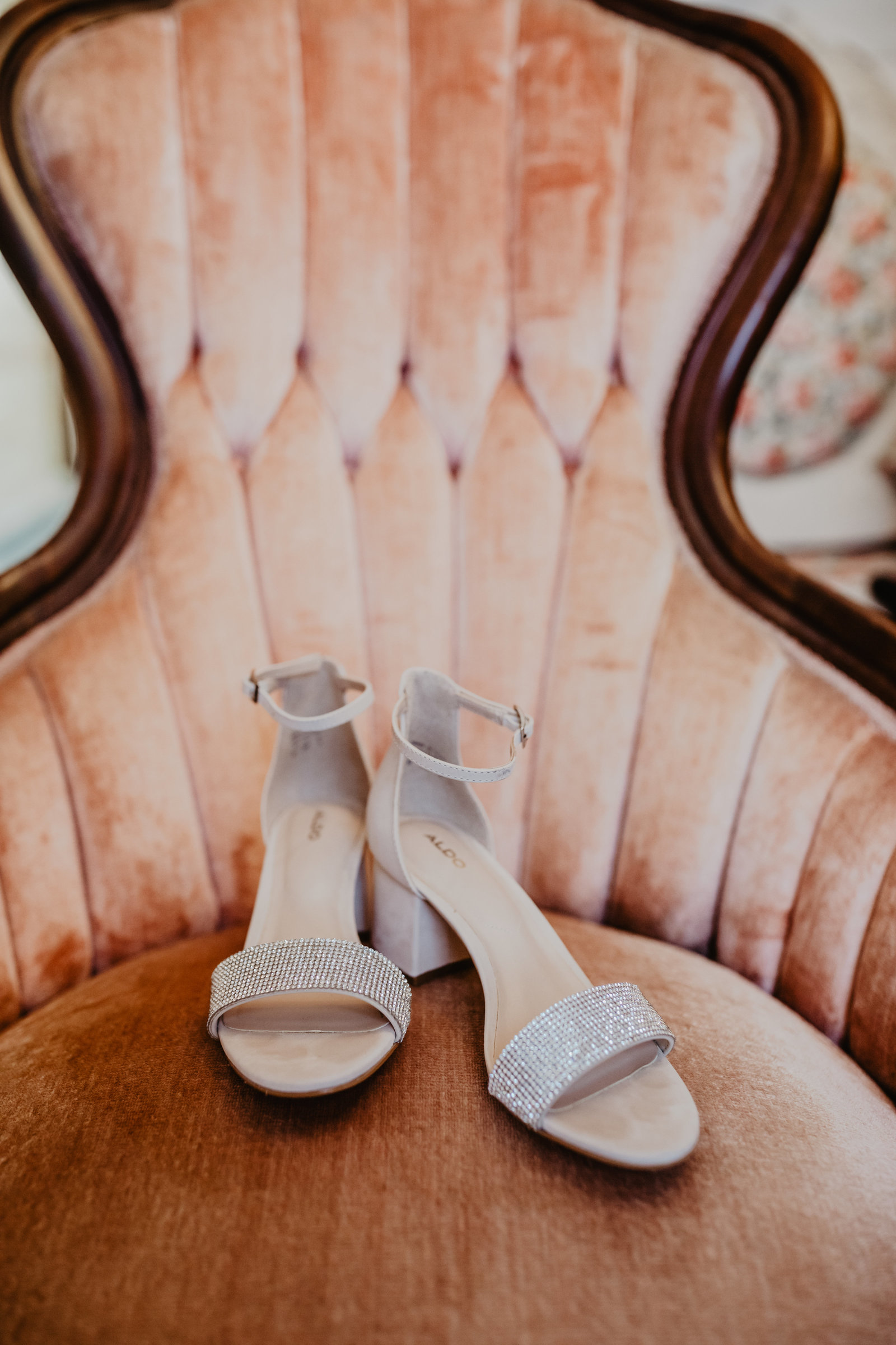 Silver wedge heels was complete on a vintage pink chair at Apple Ridge Farm