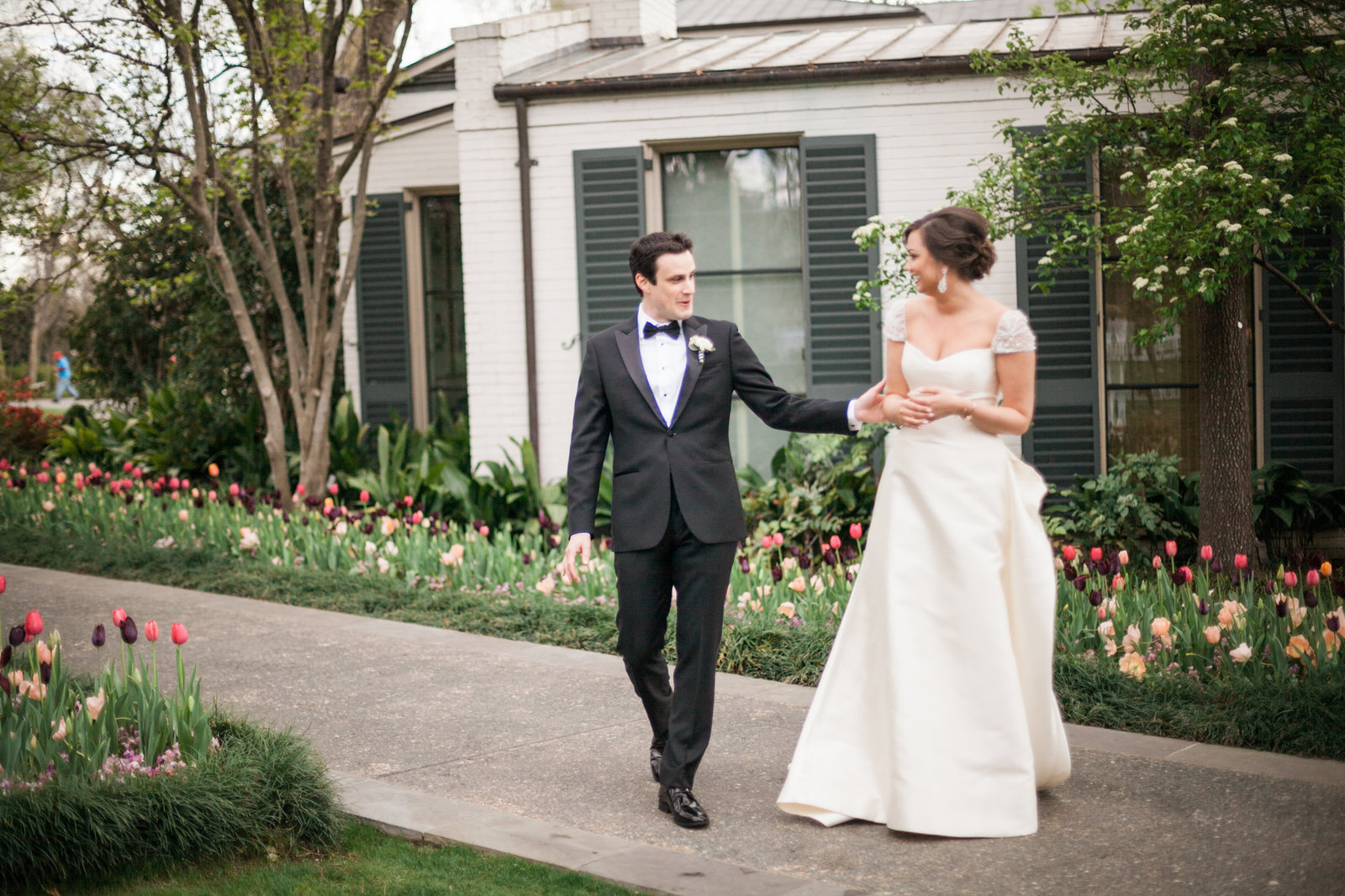 first look between the bride and groom at the dallas arboretum