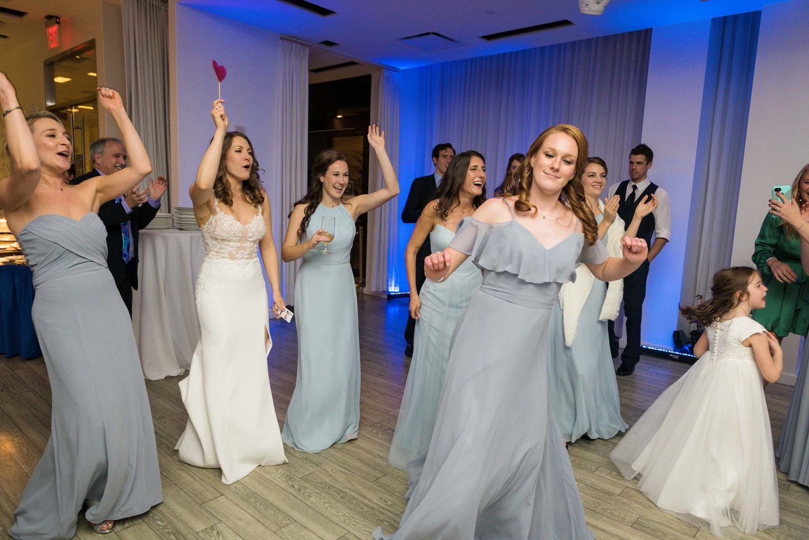 Bride and bridesmaids dancing at  Allegria Hotel