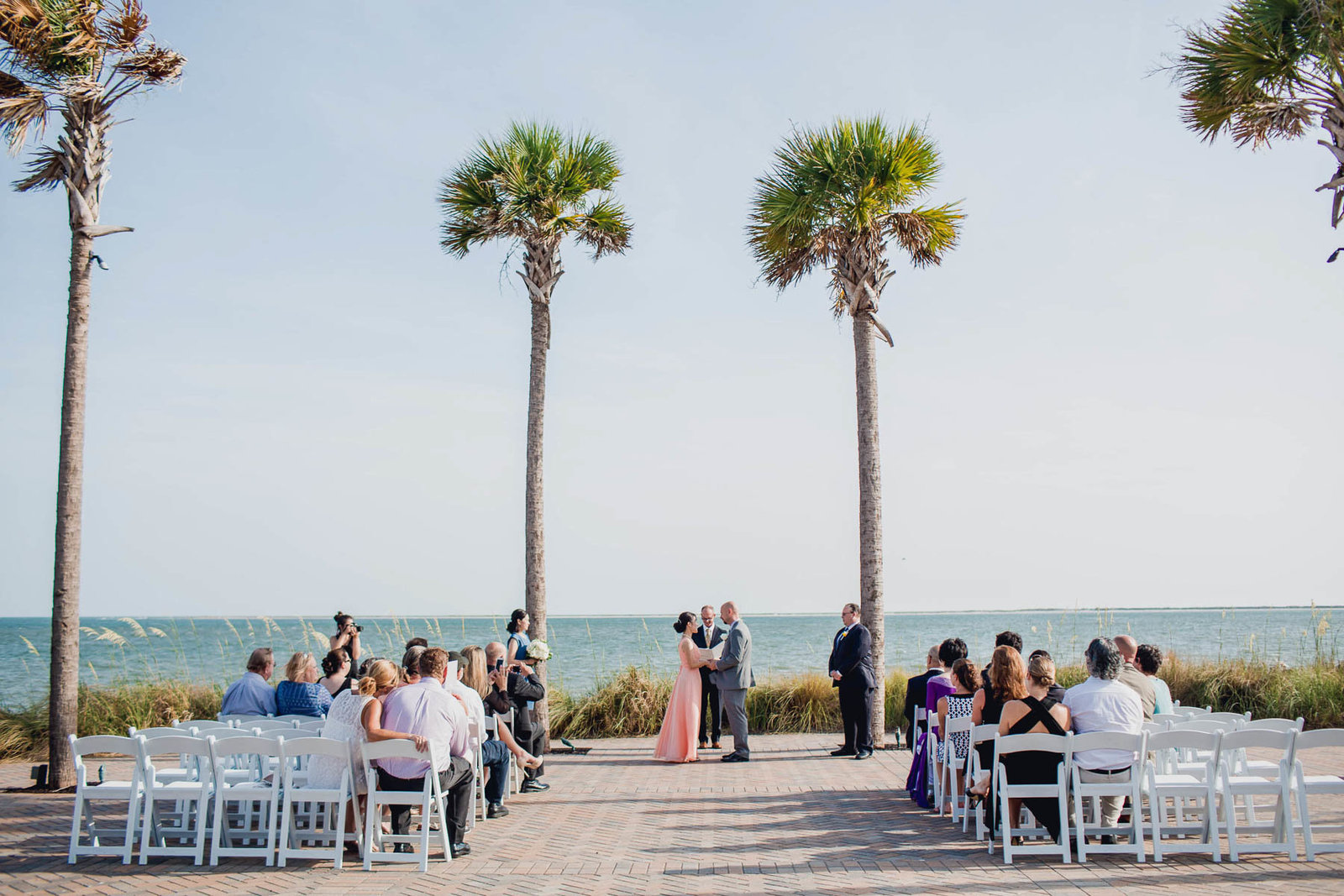 Ceremony is set up by palm trees, Seabrook Island Club, Charleston, South Carolina