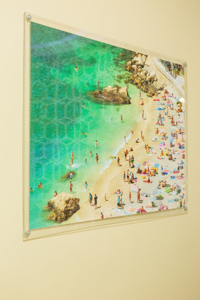 A glass framed print of beach.