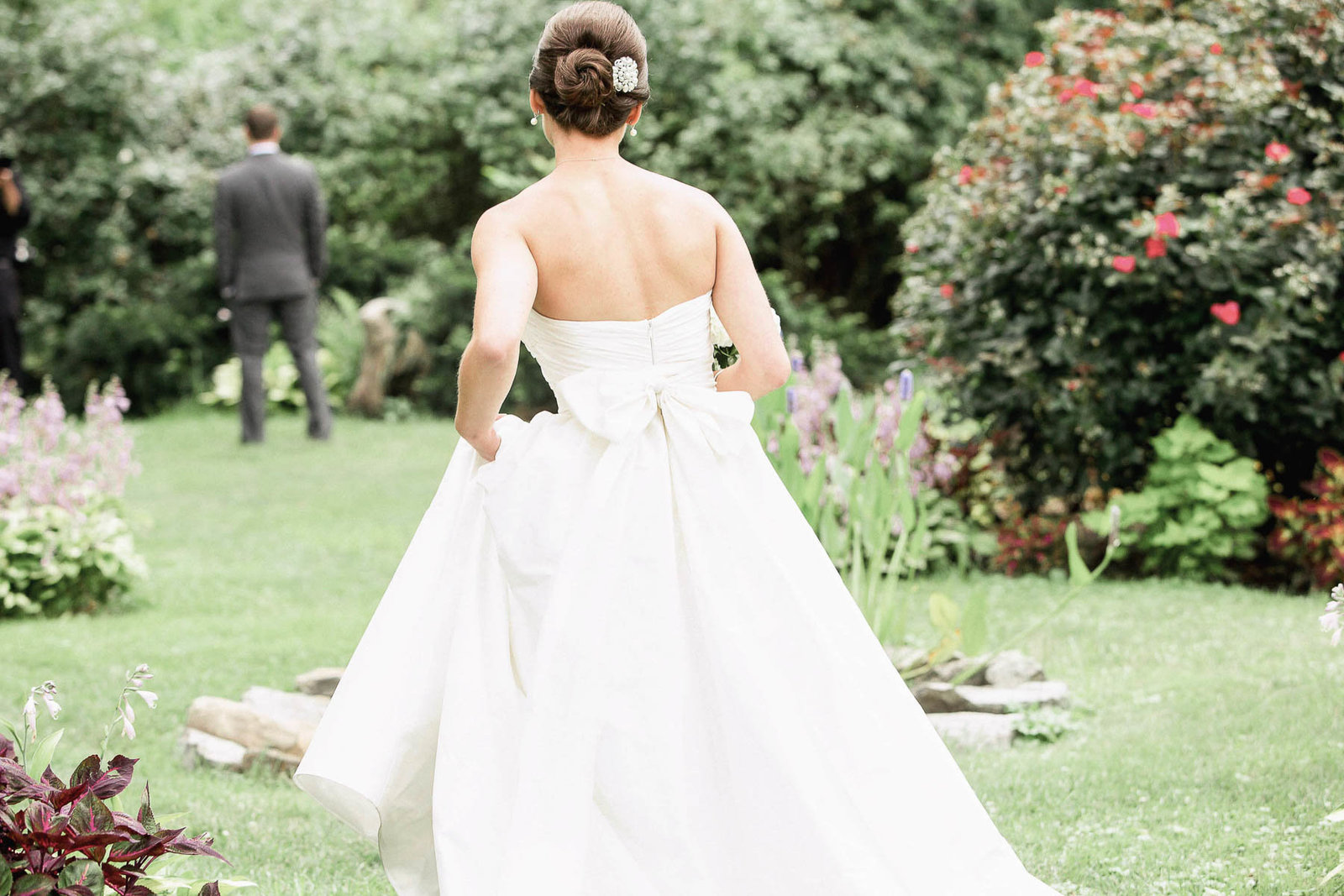 Bride walks to groom in garden during first look, Rockwood Mansion and Carriage House, Wilmington, Delaware. Kate Timbers Photography.