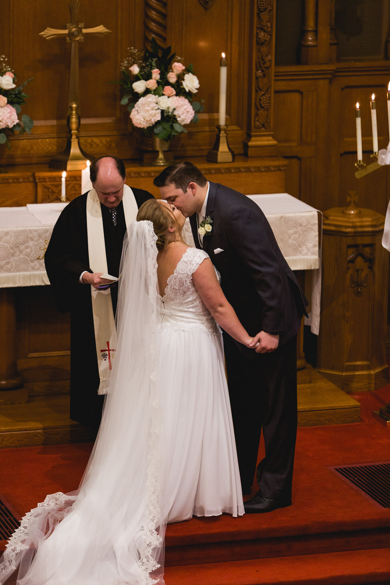 old church wedding ceremony first kiss with bride and groom ohio