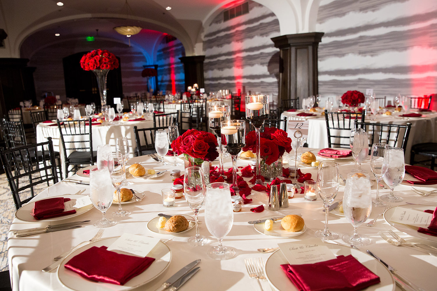 reception tables with red flowers at us grant hotel