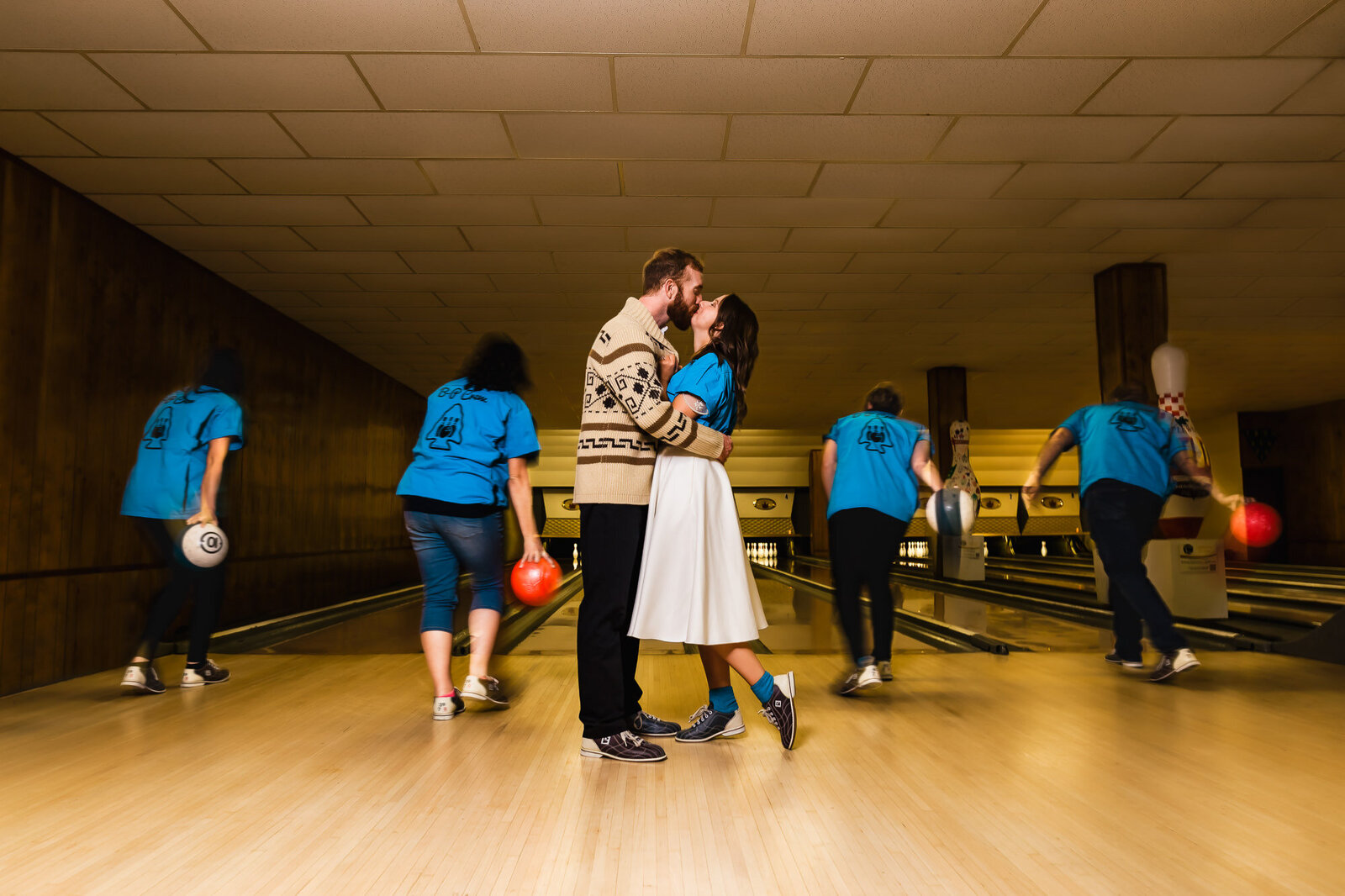 Bride and groom kissing at their bowling wedding reception at Saratoga Lanes in St. Louis