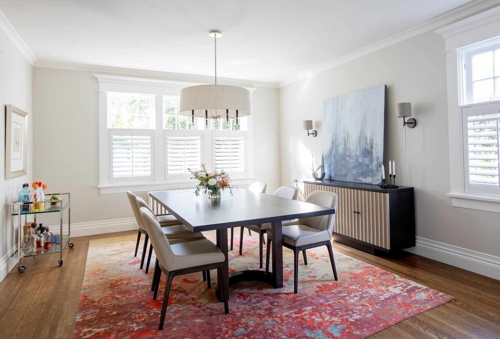 Granville Street l Dining Room l Custom Alexis Dining Table on Bright Colour Rug with Traditional Chandelier and Modern Sideboard