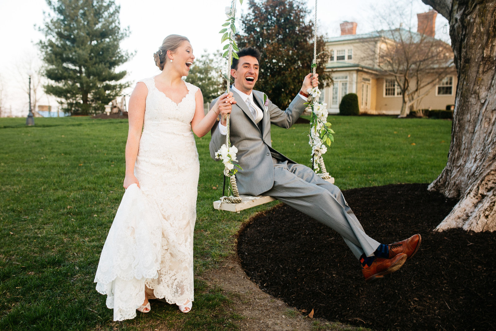 wedding couple laughing on tree swing St Louis Pinxit Photo