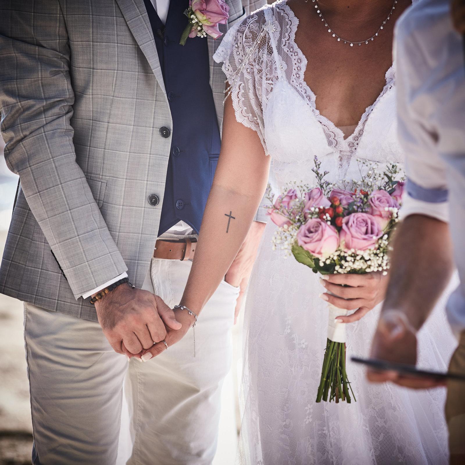 Couple holding hands during ceremony