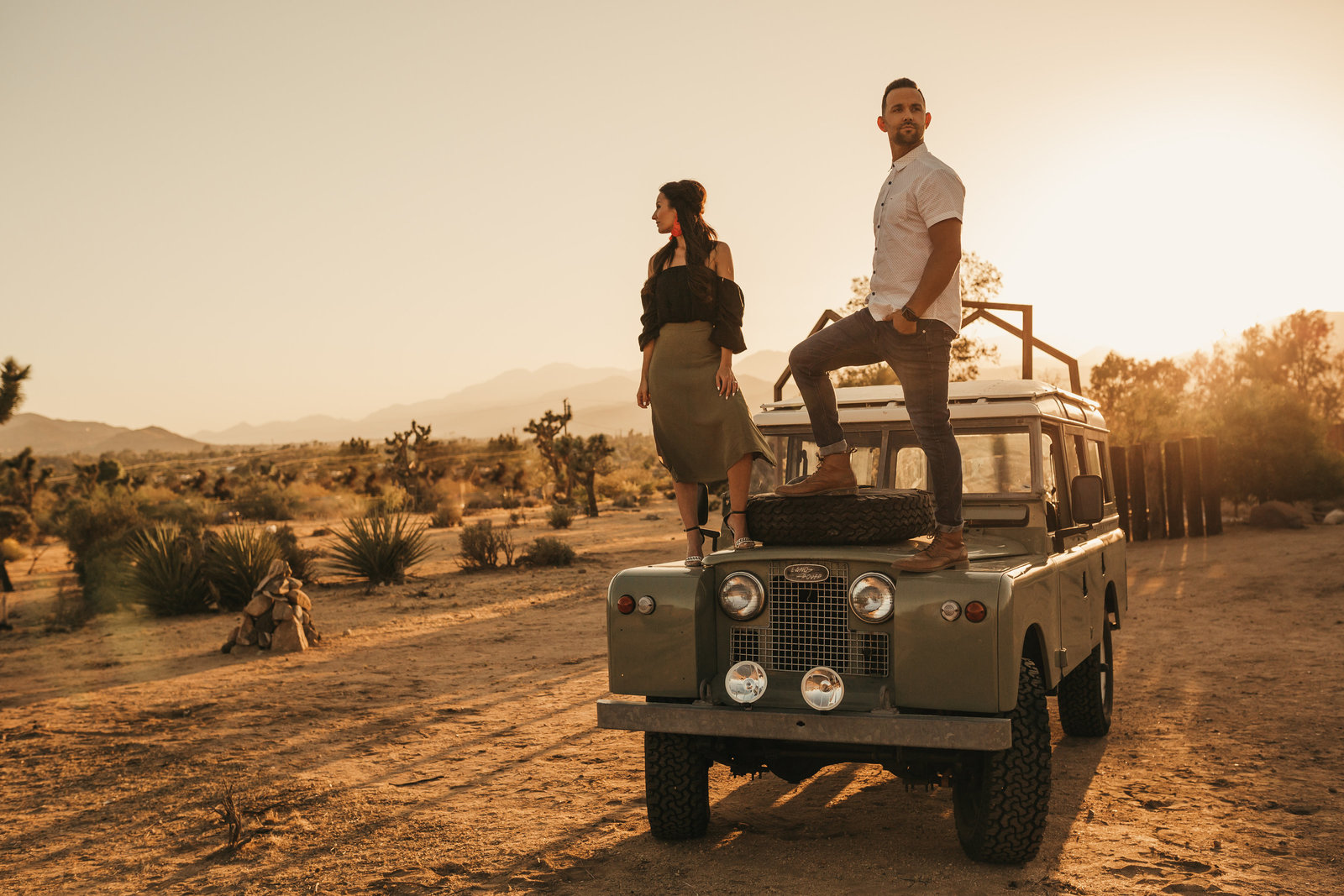 couple standing on jeep