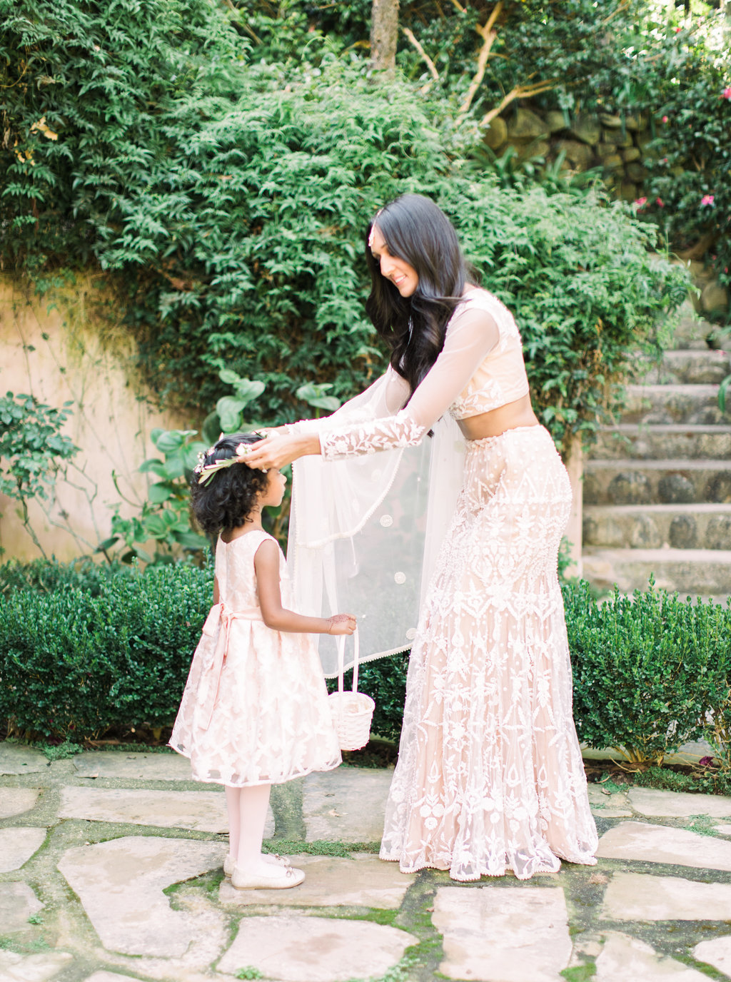 Bride in traditional white wedding saree and flower girl at Butterly Lane Estate wedding