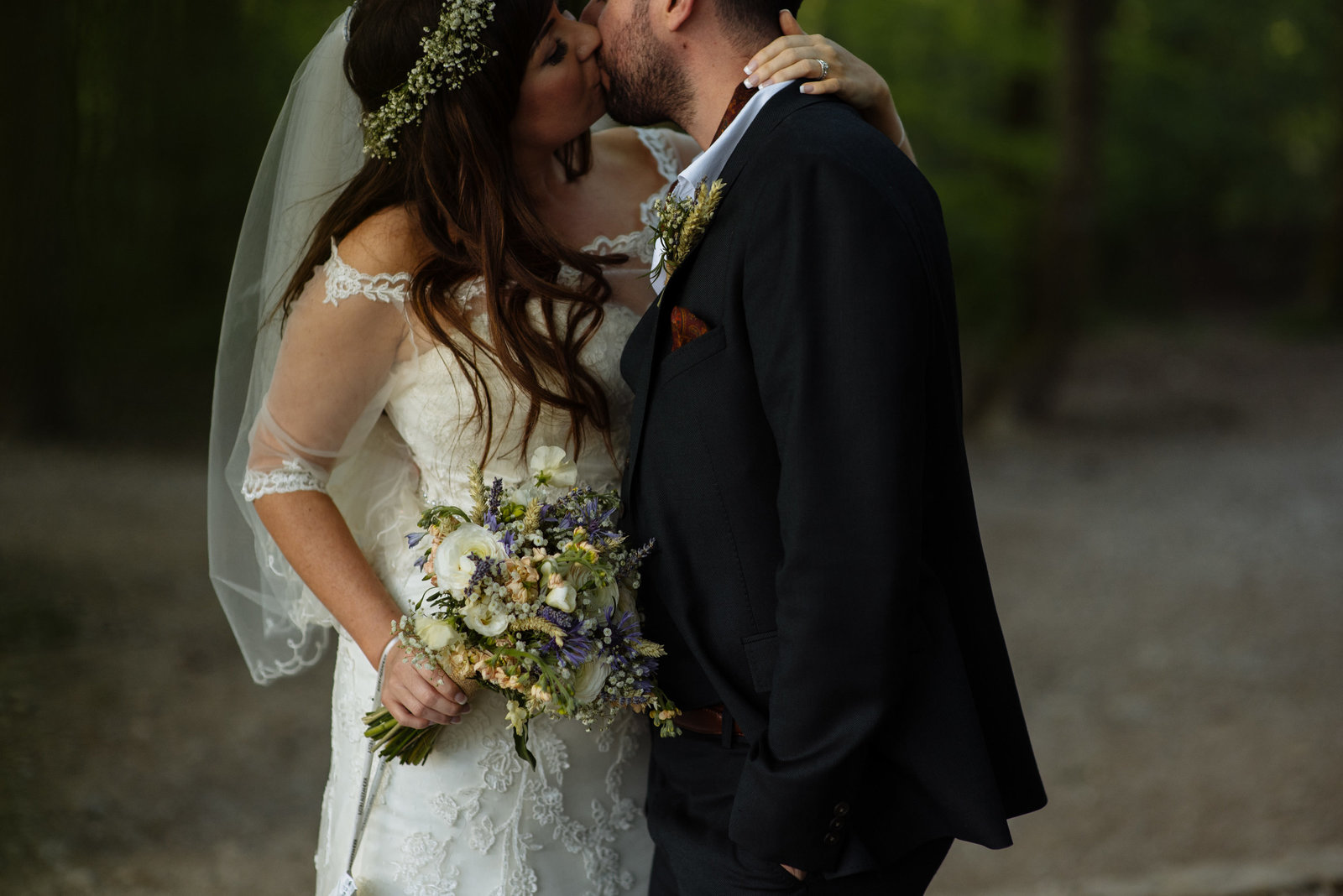 Bride and groom kissing at Otley Chevin after their wedding at the Cheerful Chilli. Leeds wedding photography