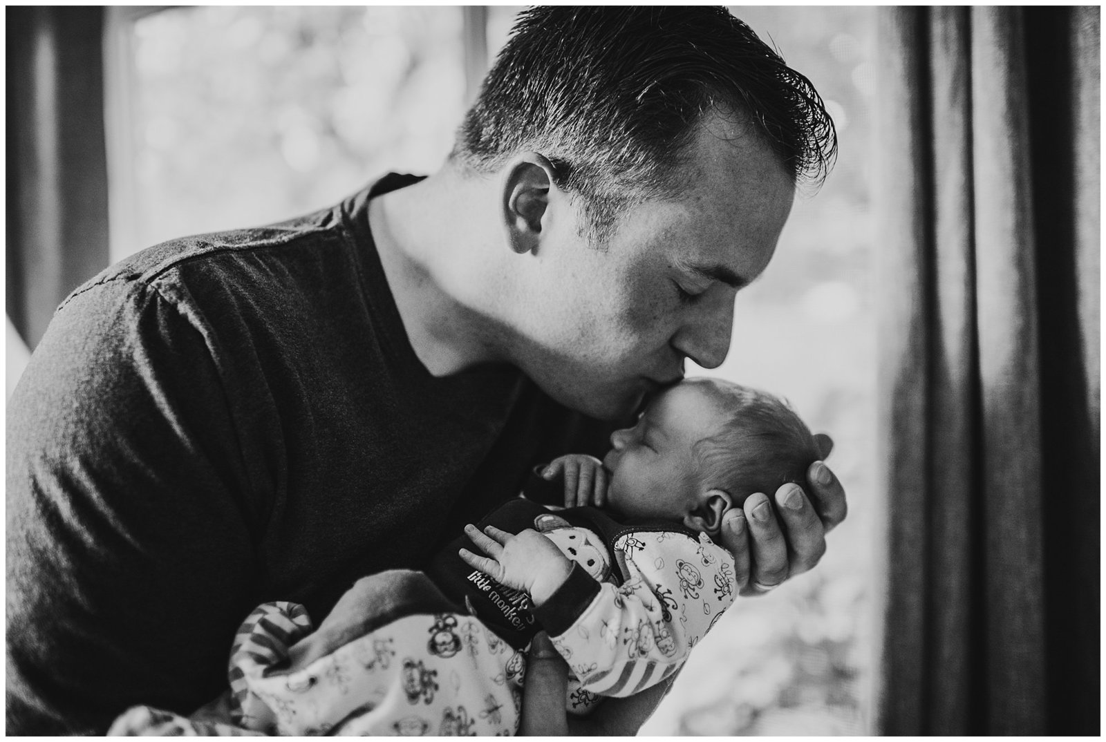 dad kissing newborn baby boy black and white photo Emily Ann Photography Seattle Photographer