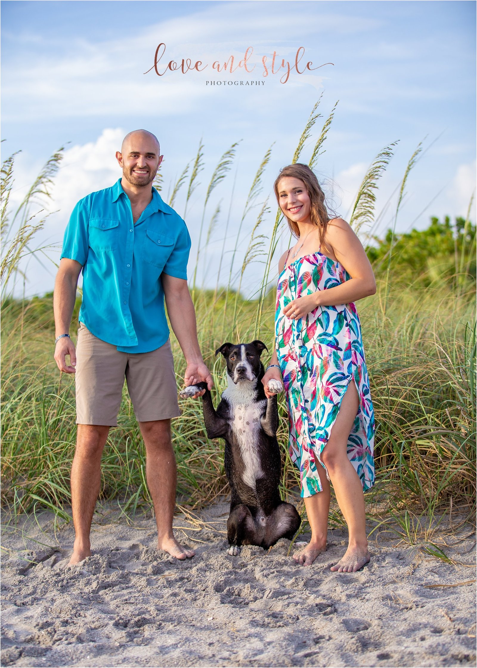 Engagement Photography at Venice Dog Beach of couple holding hands with their dog