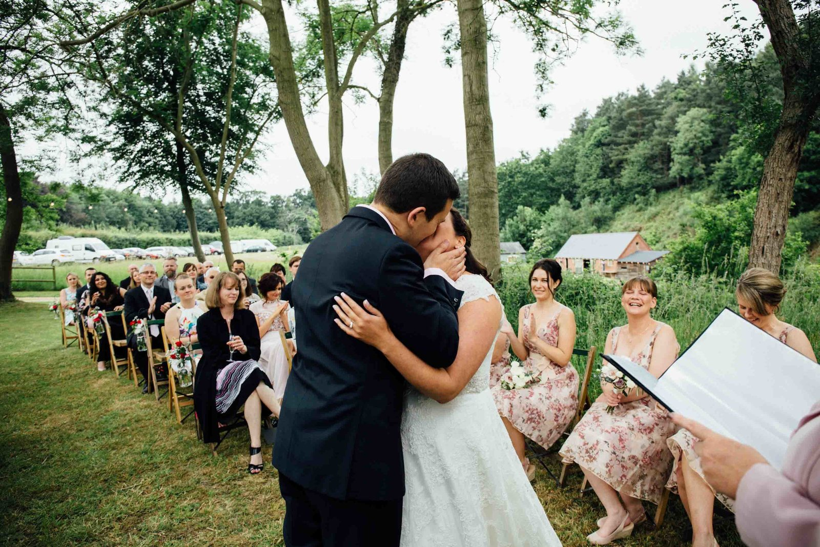 Bride and Groom first kiss as newlyweds at outdoor Keeper and The Dell ceremony in Norfolk