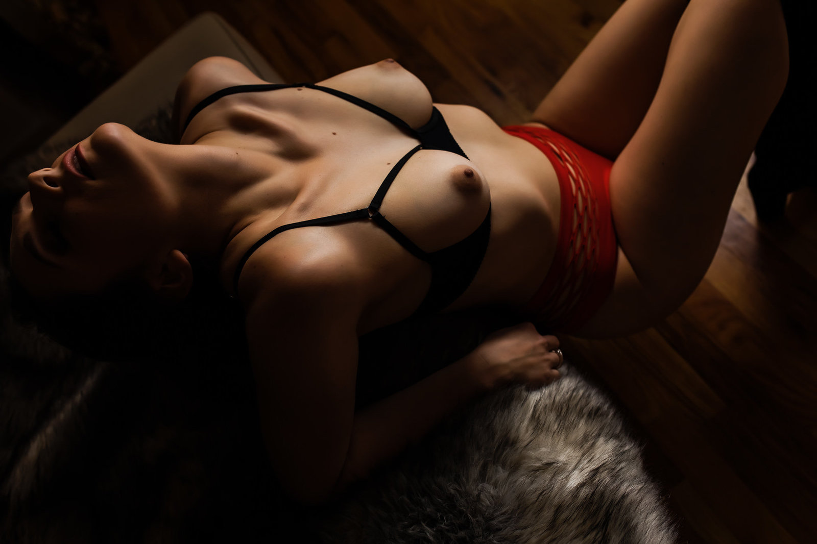 Erotic topless boudoir photo of a woman