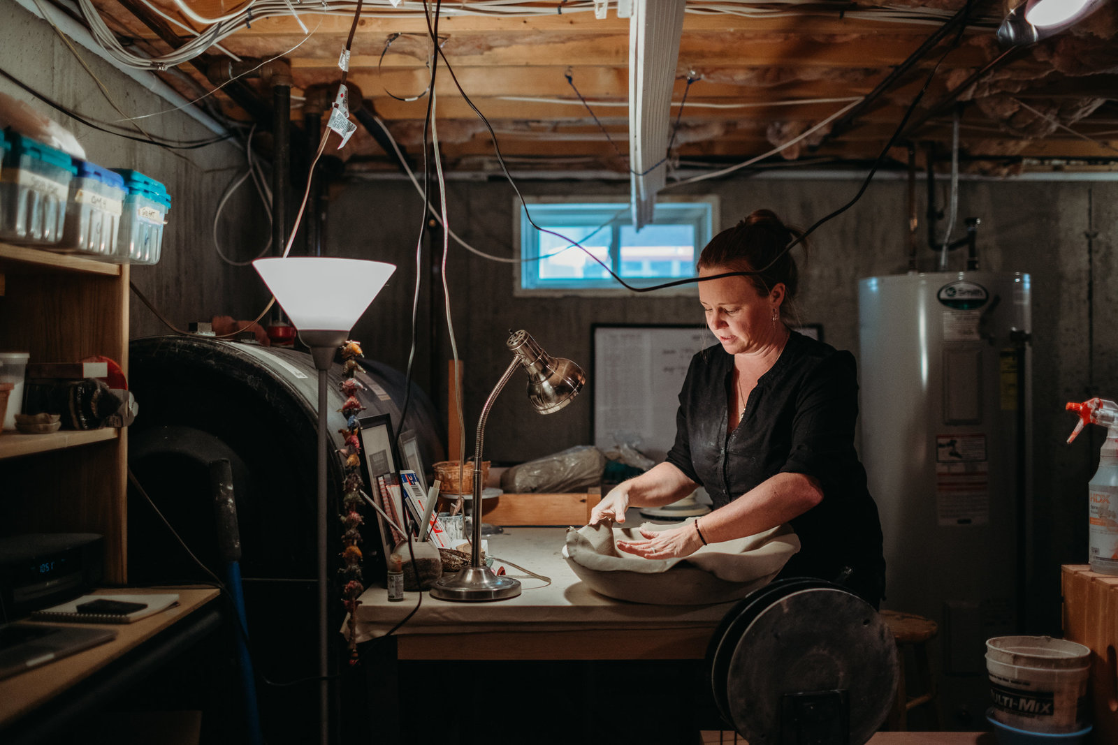 woman does hand building during pottery images