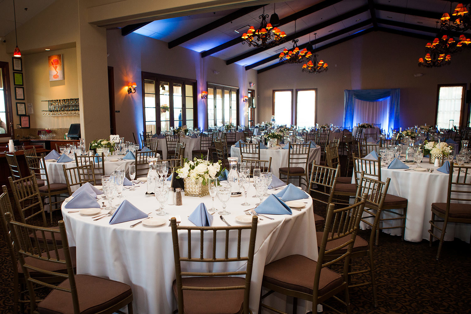 reception space at wedgewood blue uplighting