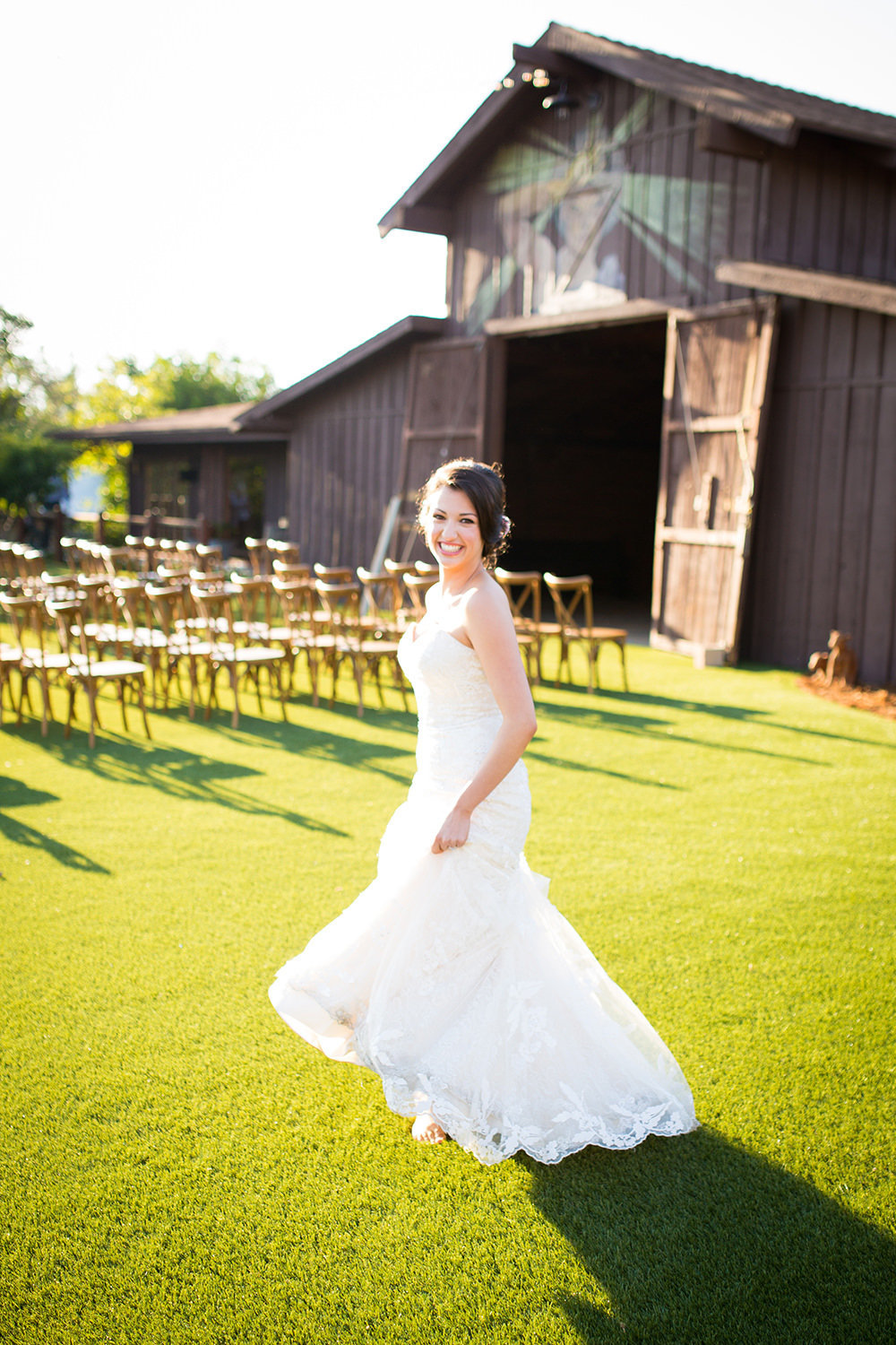 bride with barn in background