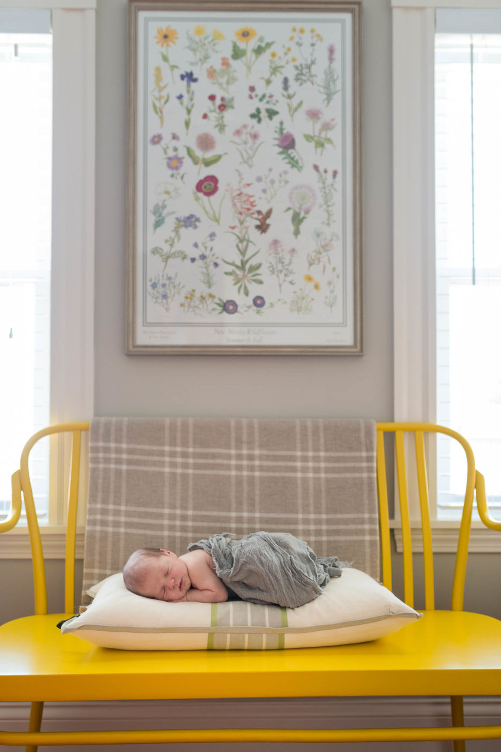 Newborn posed at home lifestyle session Boston in chair