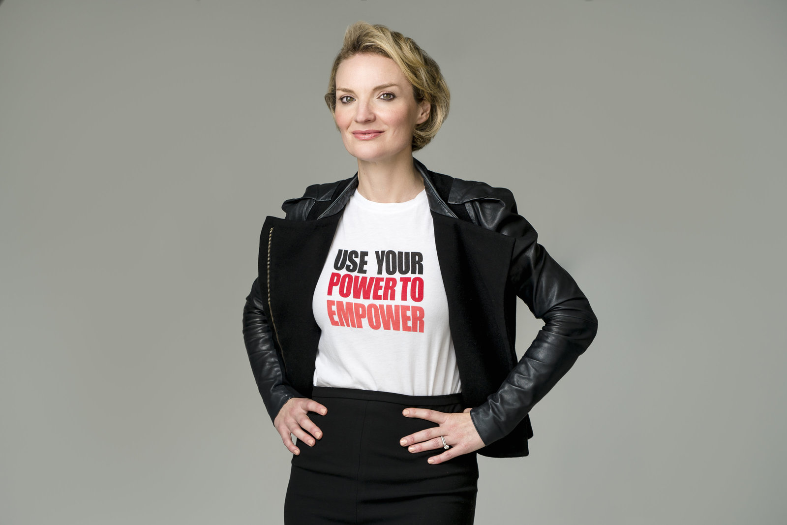 Elyse Nelson commissioned Adrienne Longo of Electric Love Studios to take a headshot portrait of her in an empowering tee shirt and black leather jacket.