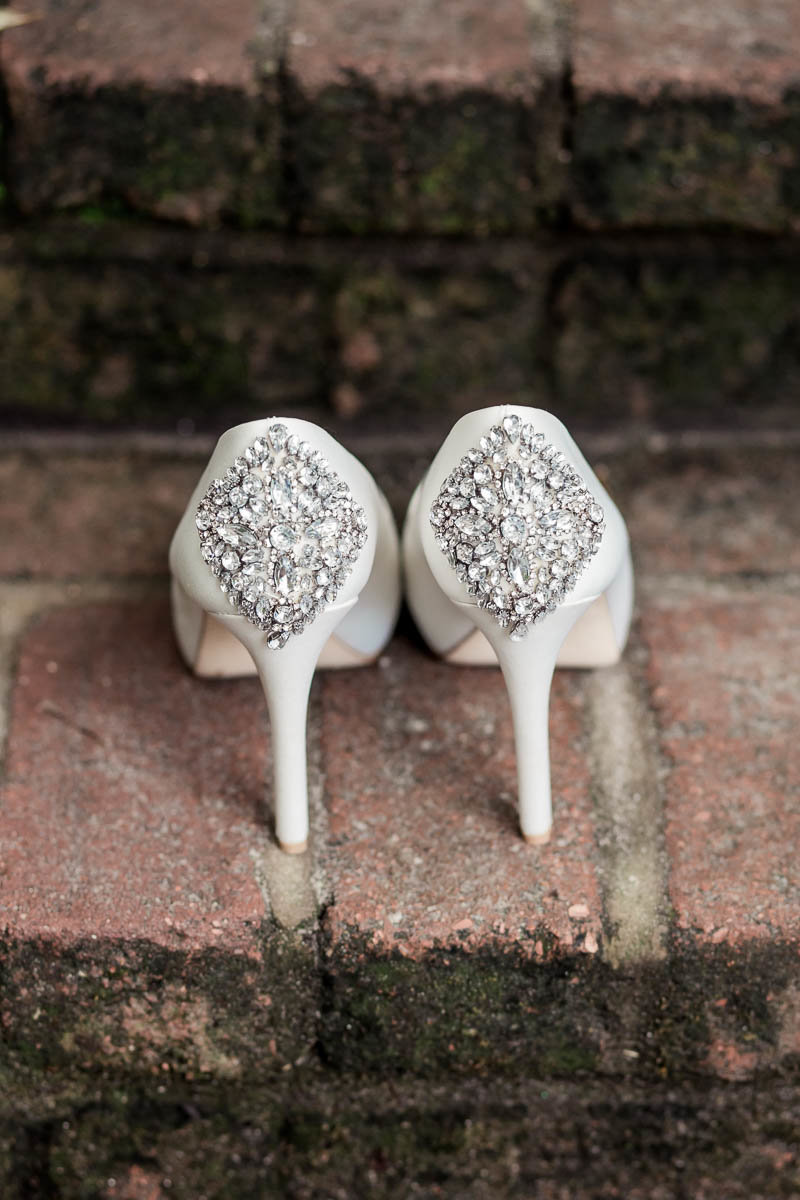 The bride's shoes sit on brick step, Magnolia Plantation, Charleston, South Carolina. Kate Timbers Photography.