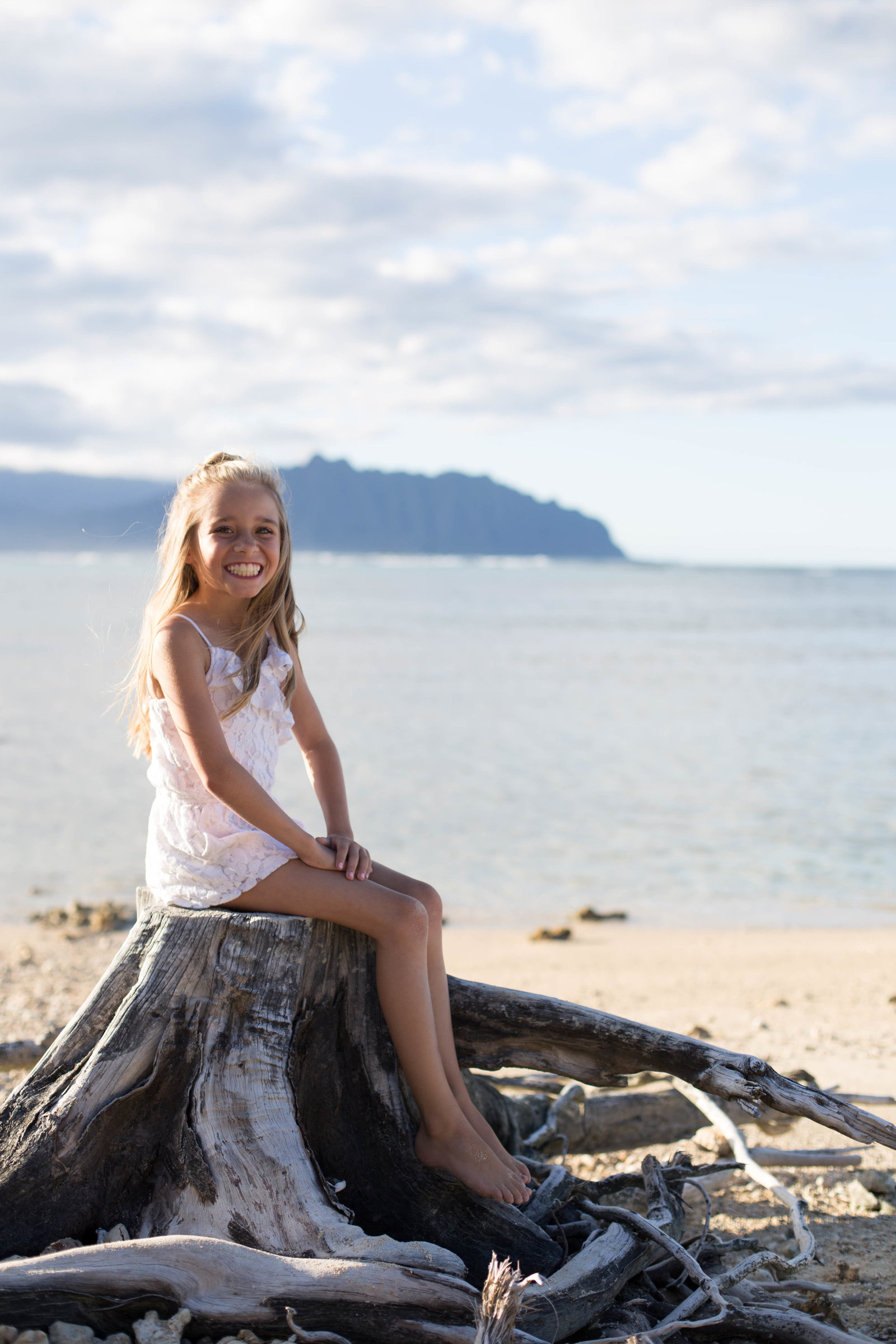 Oahu, Hawaii Lifestyle Photographer - Lifestyle Photography - Brooke Flanagan Photography - Little Girl Posing on an old stump