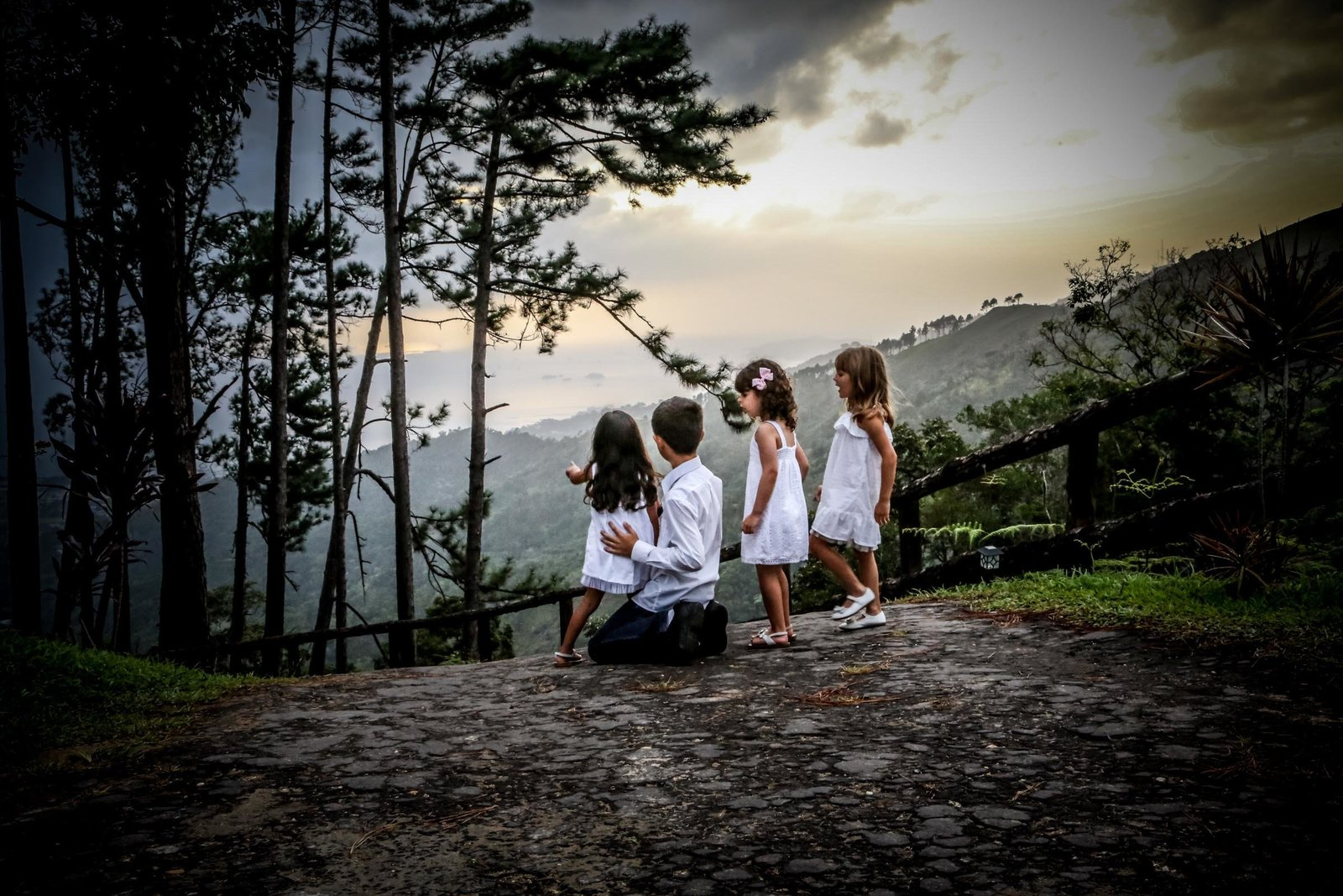 Four young children look at an expansive view. Photo by Ross Photography, Trinidad, W.I..