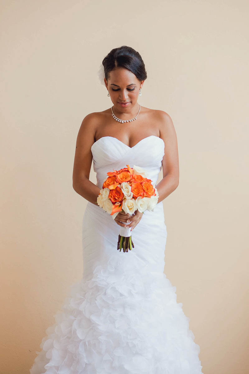 Bride poses, Jamaican Destination Wedding, Iberostar Rose Hall Suites, Montego Bay. Kate Timbers Photography.