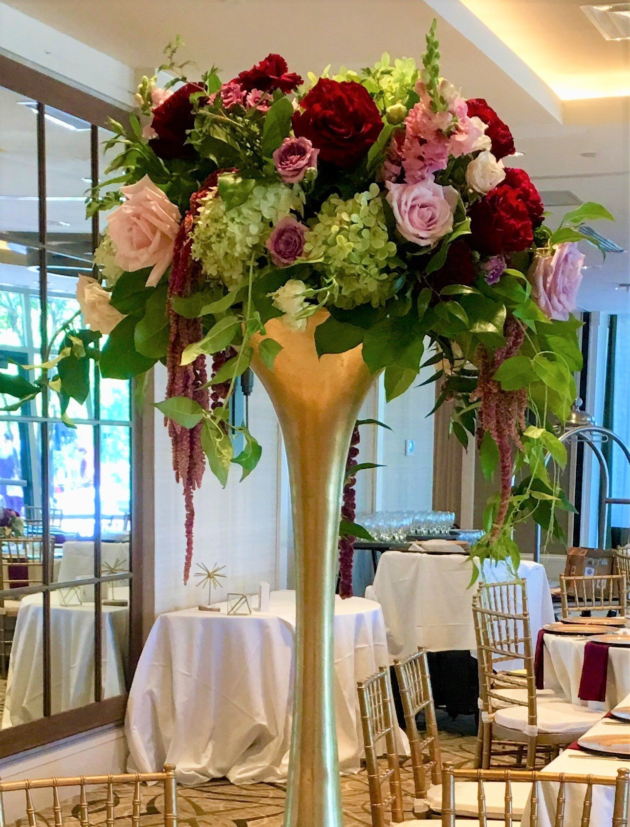 Elevated floral arrangement with roses and hydrangeas
