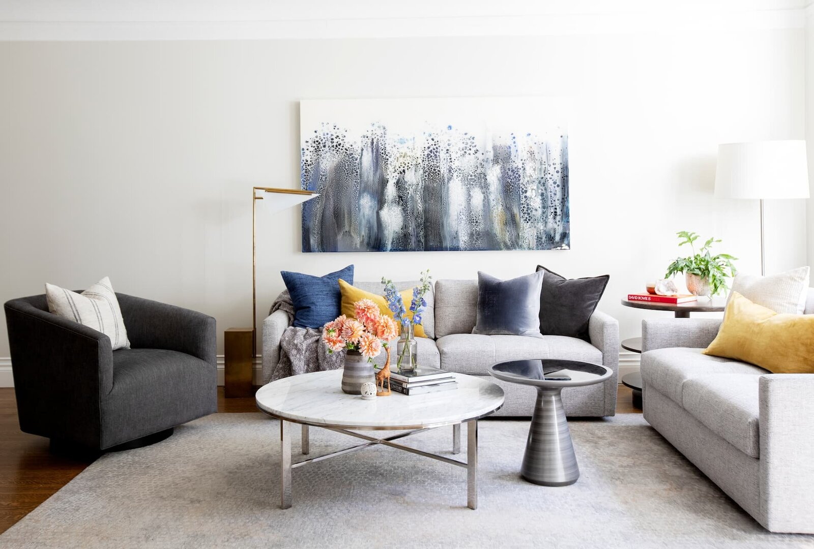 Granville Street l Living-TV Room l Conversational Seating Area of Grey Sofas and Chair with Coffee Table Layering