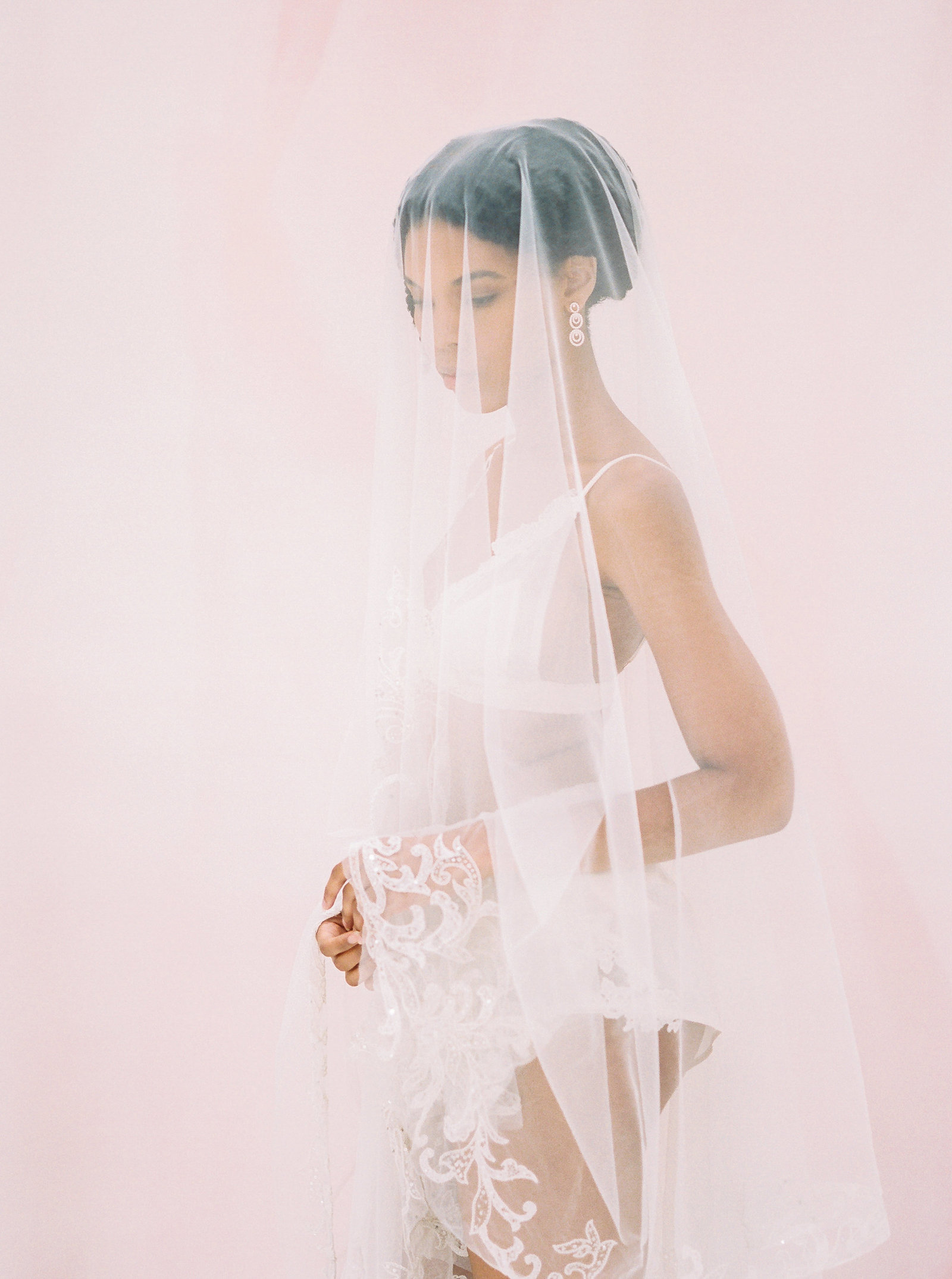 bride in lingerie covered by white veil