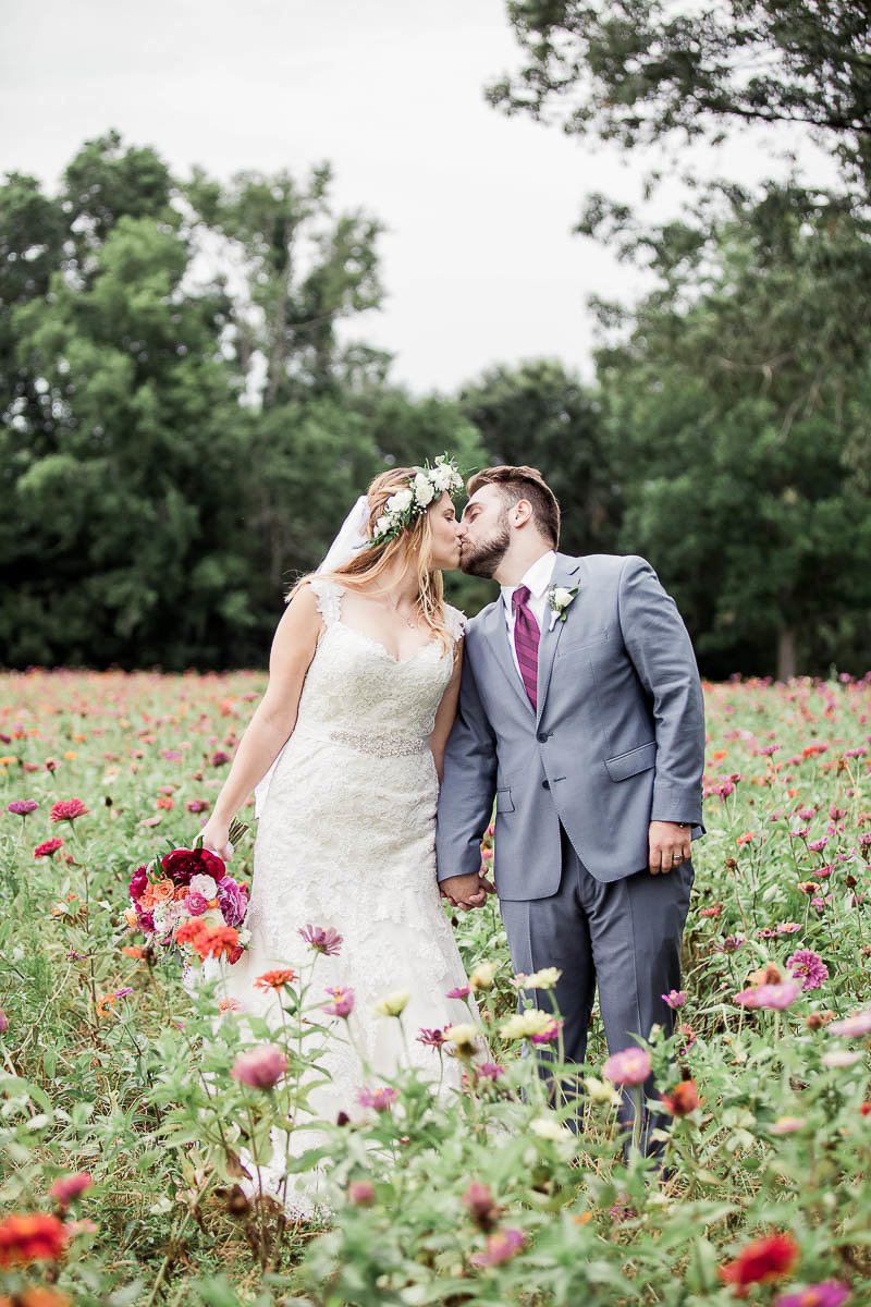 Bride and groom pose together in field, The Island House, Charleston, South Carolina