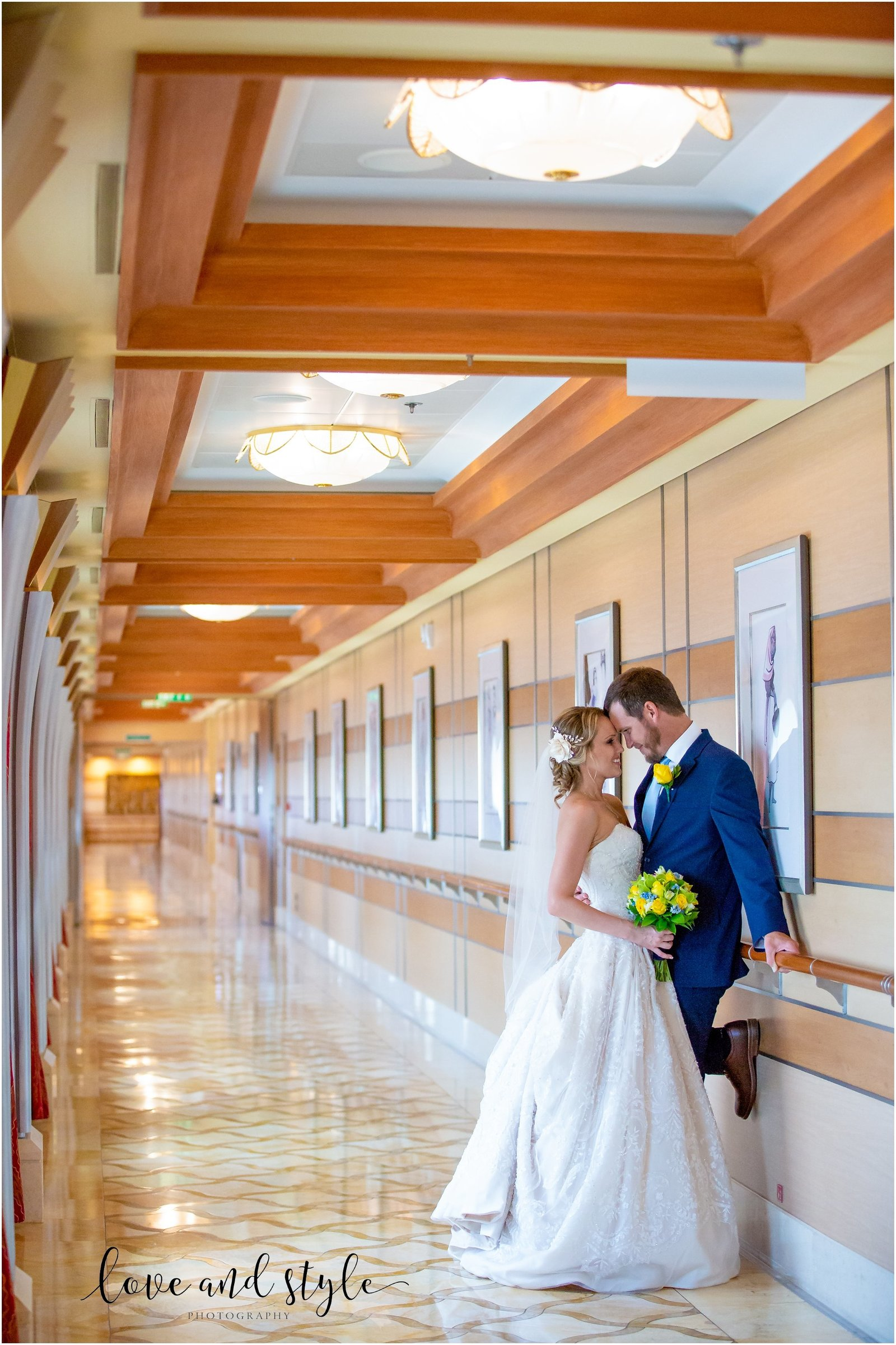 Disney Dream Cruise Wedding Photography bride and groom portrait in the hallway kissing
