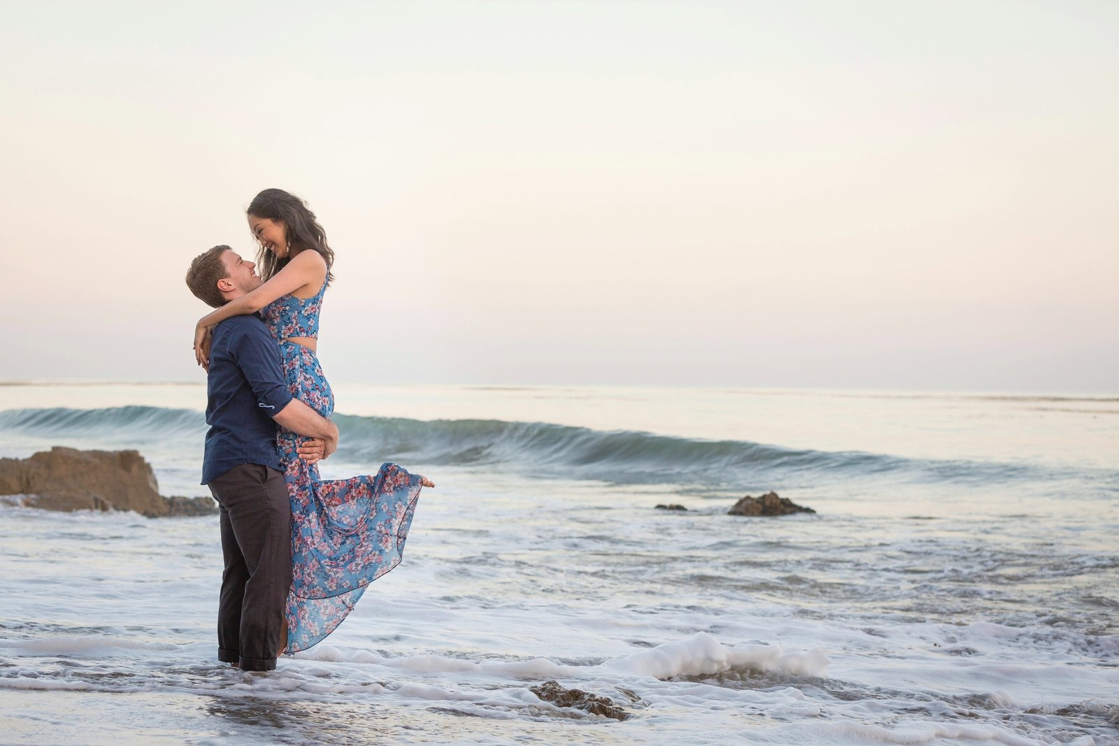 engagement couple embracing  a the ocean