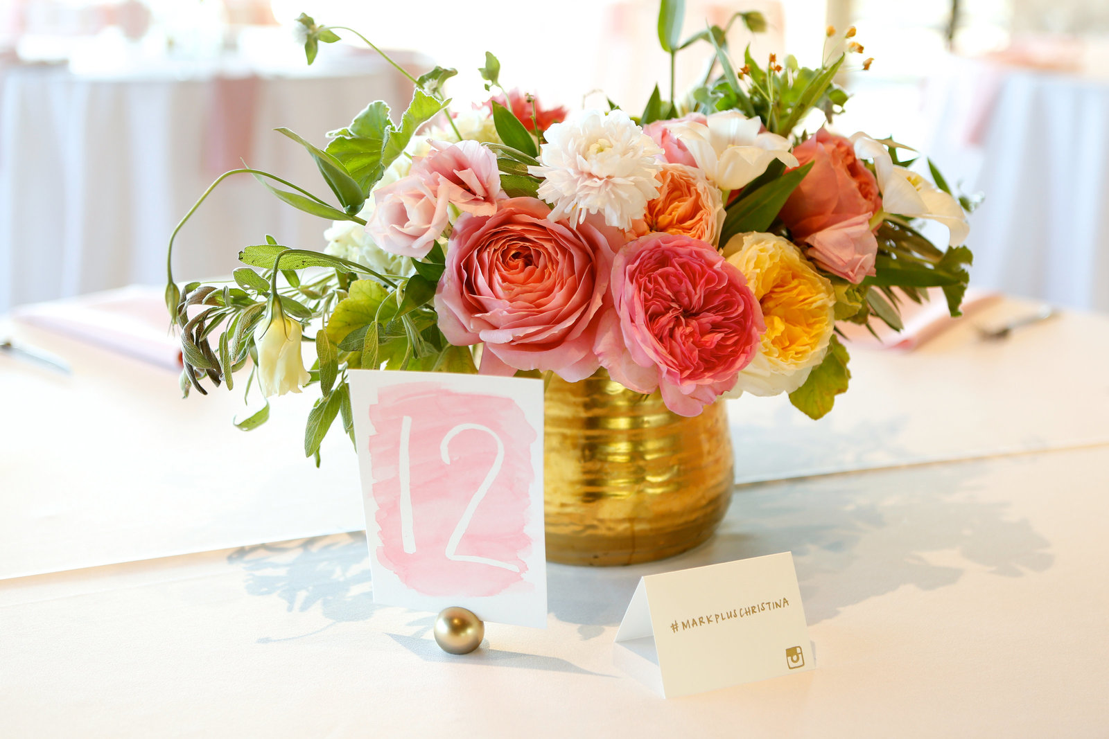 gilded, colorful and lush centerpiece with watercolor table number