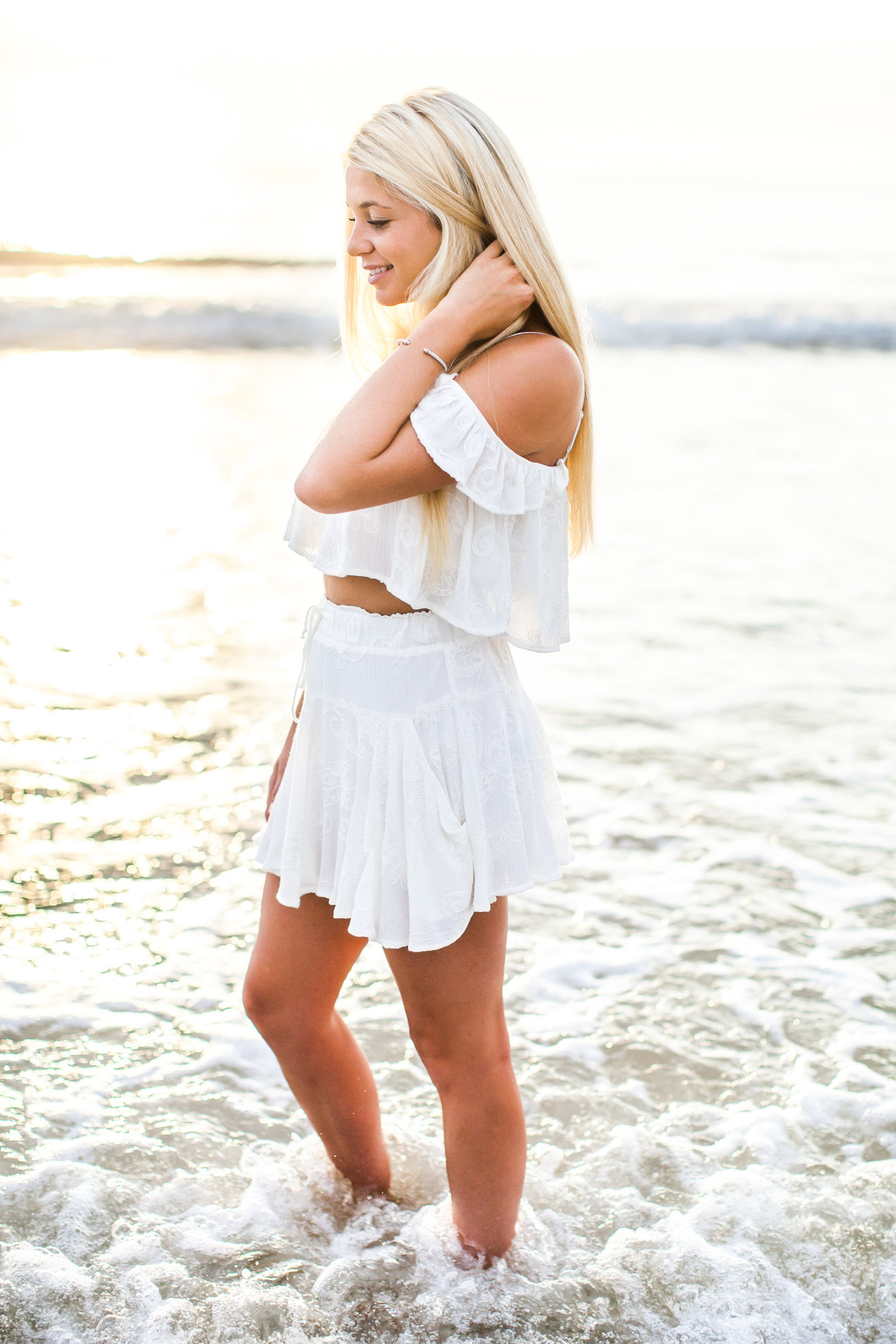 Sunrise pictures at the beach in all white outfit