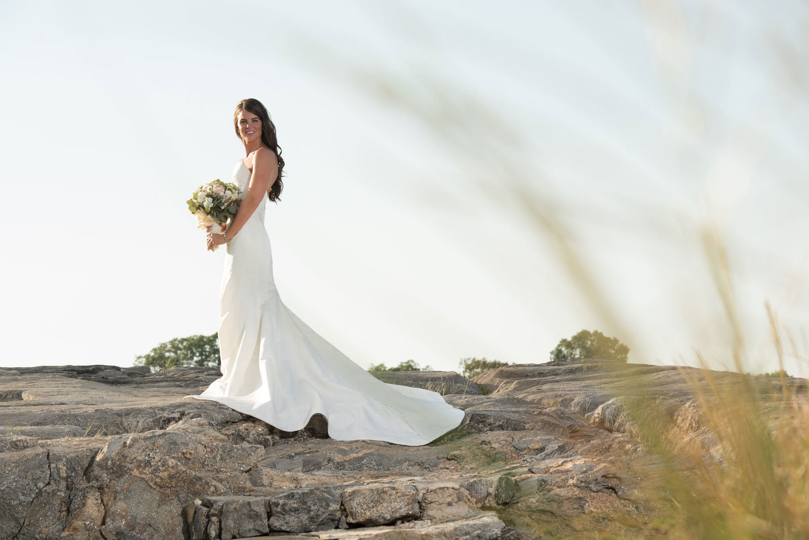 bride standing on the rocks at Glen Island Harbor Club