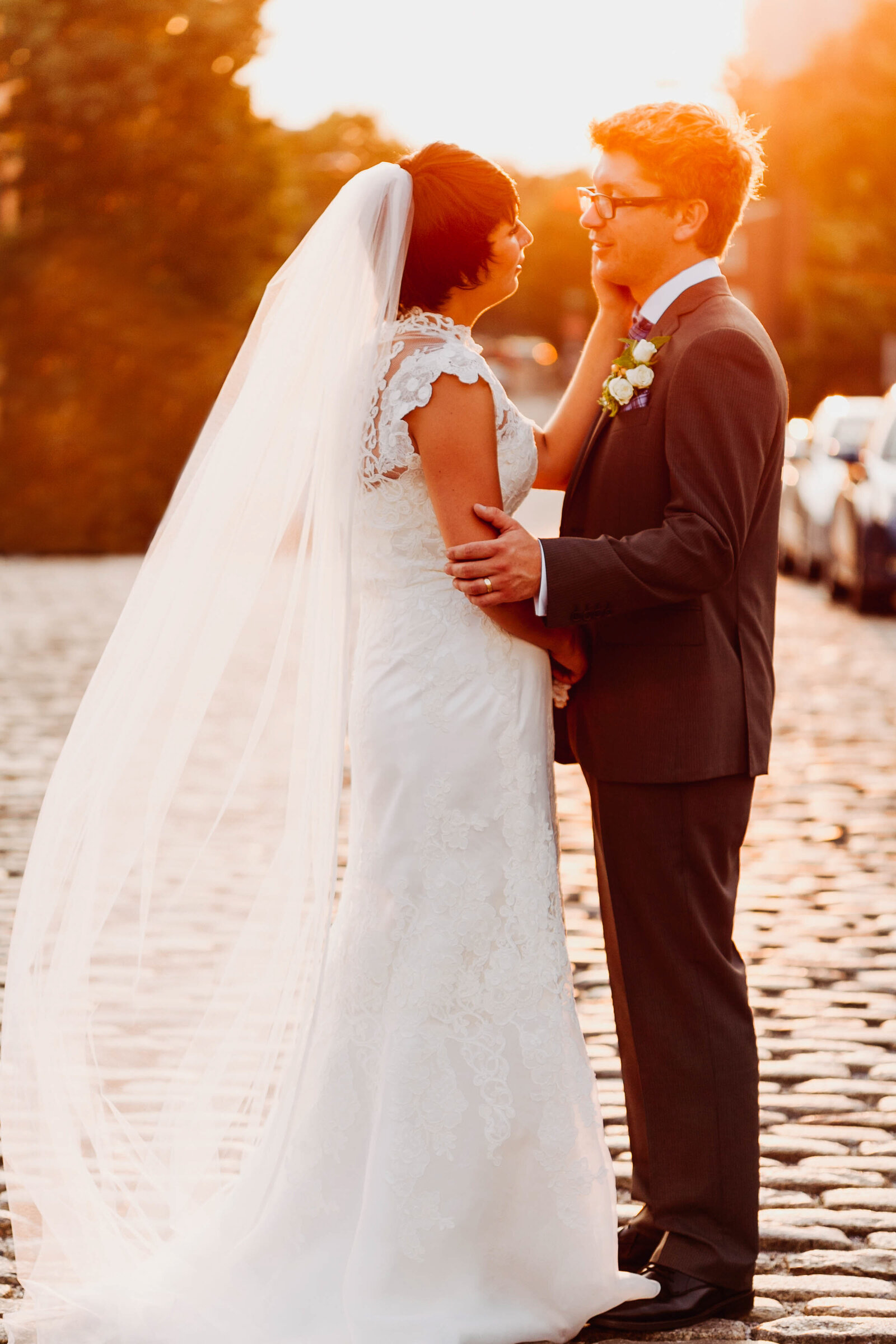 bride and groom at sunset in cobblestone street