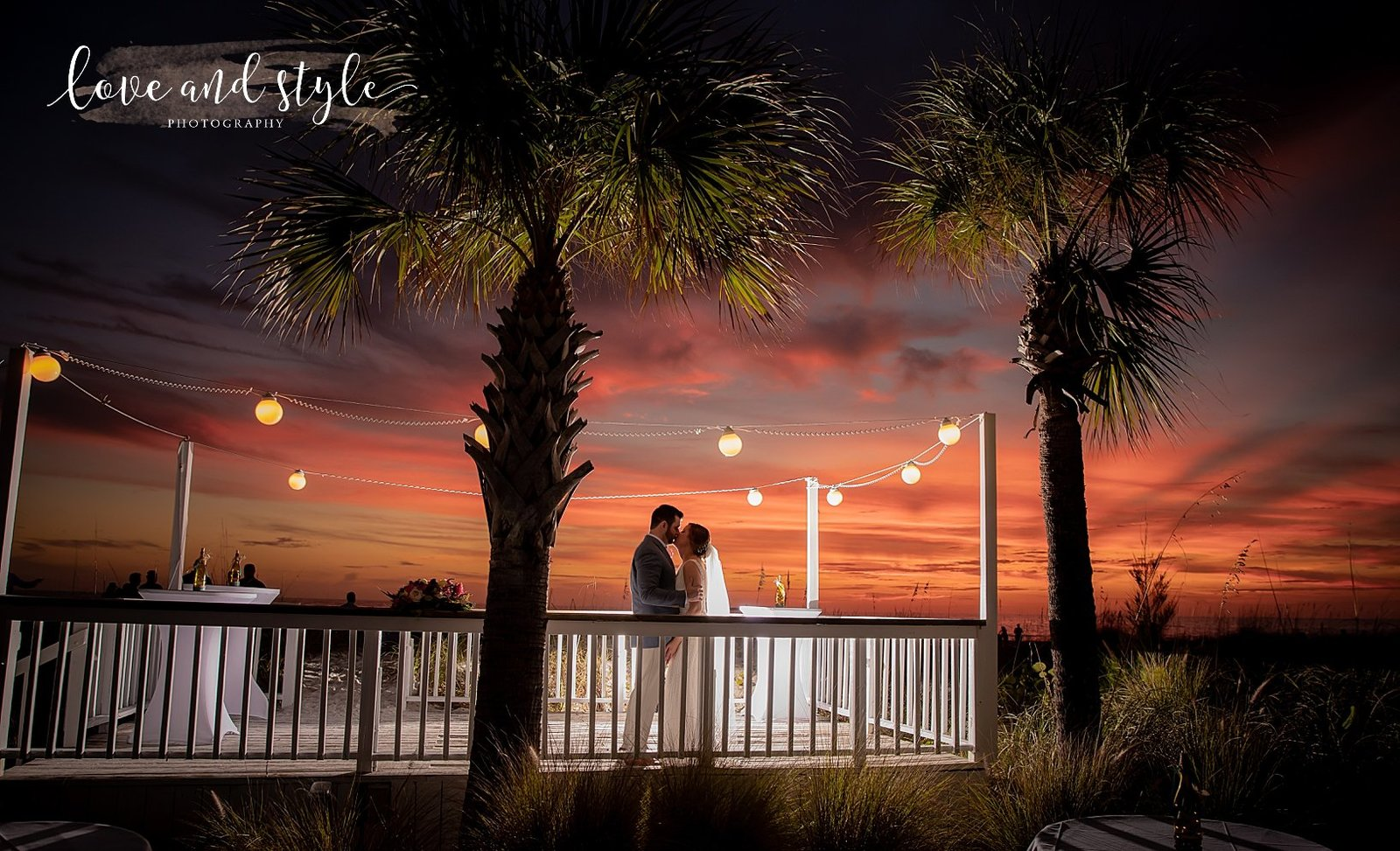 Bride and Groom backlit at The Sandbar Restaurant on Anna Maria Island at sunset