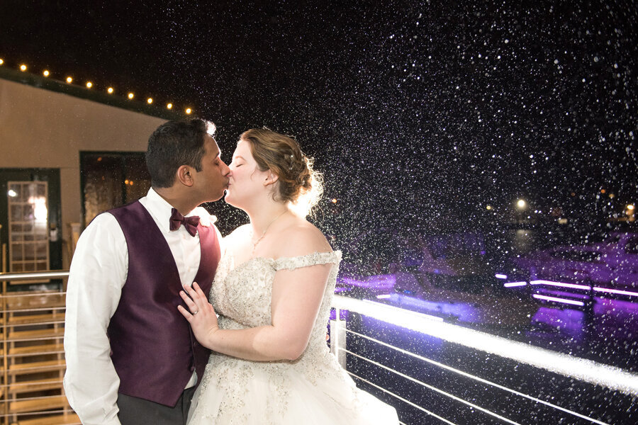 Night shot in rain of bride and groom