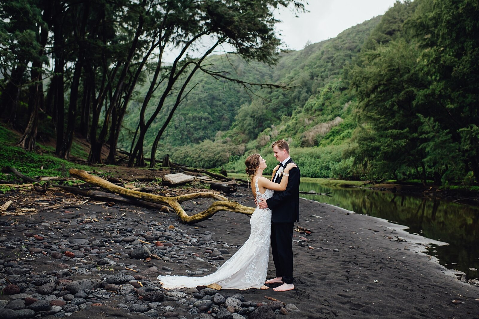 bride and groom on black sand beach