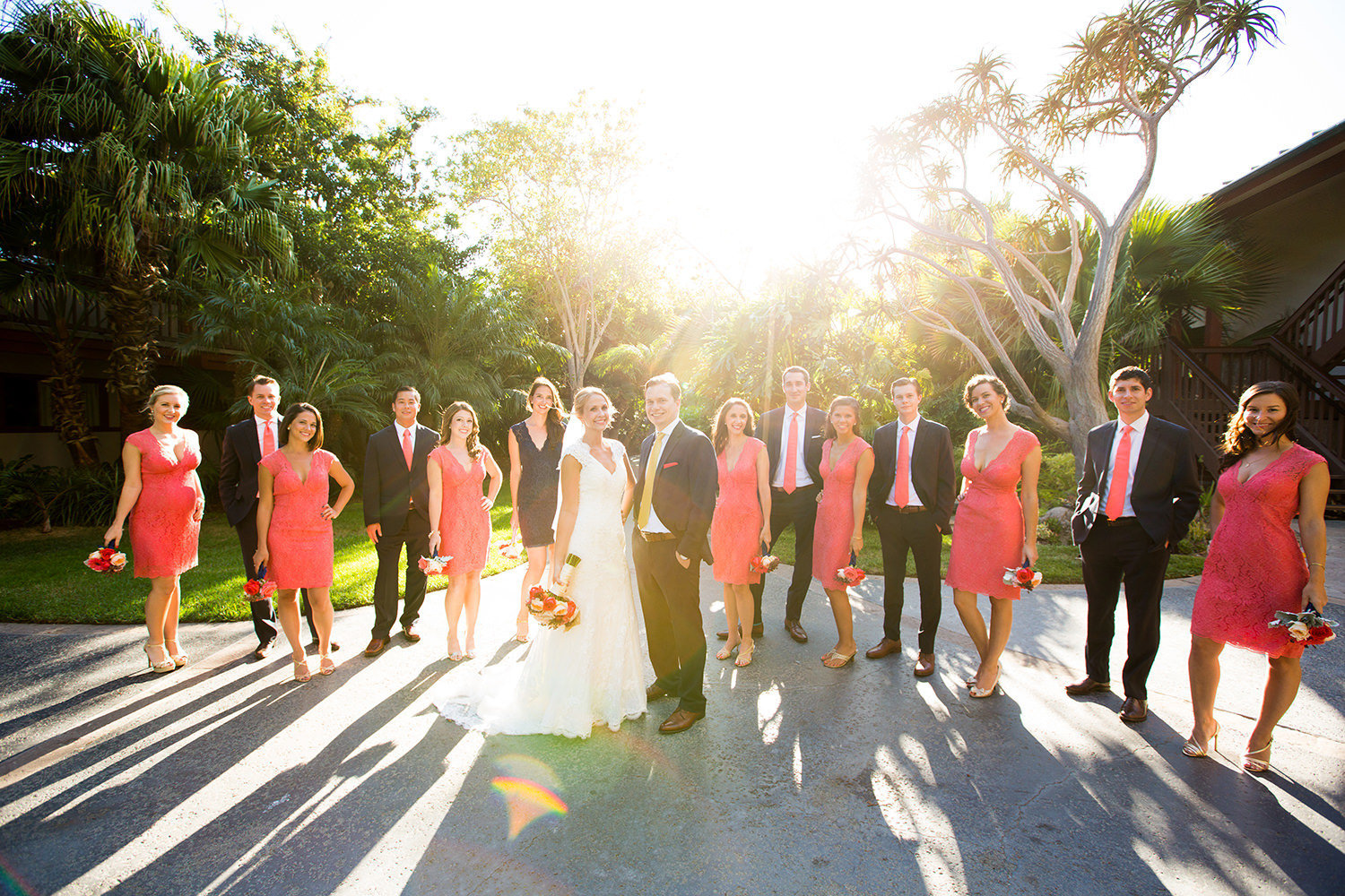 bridal party with sunset in background